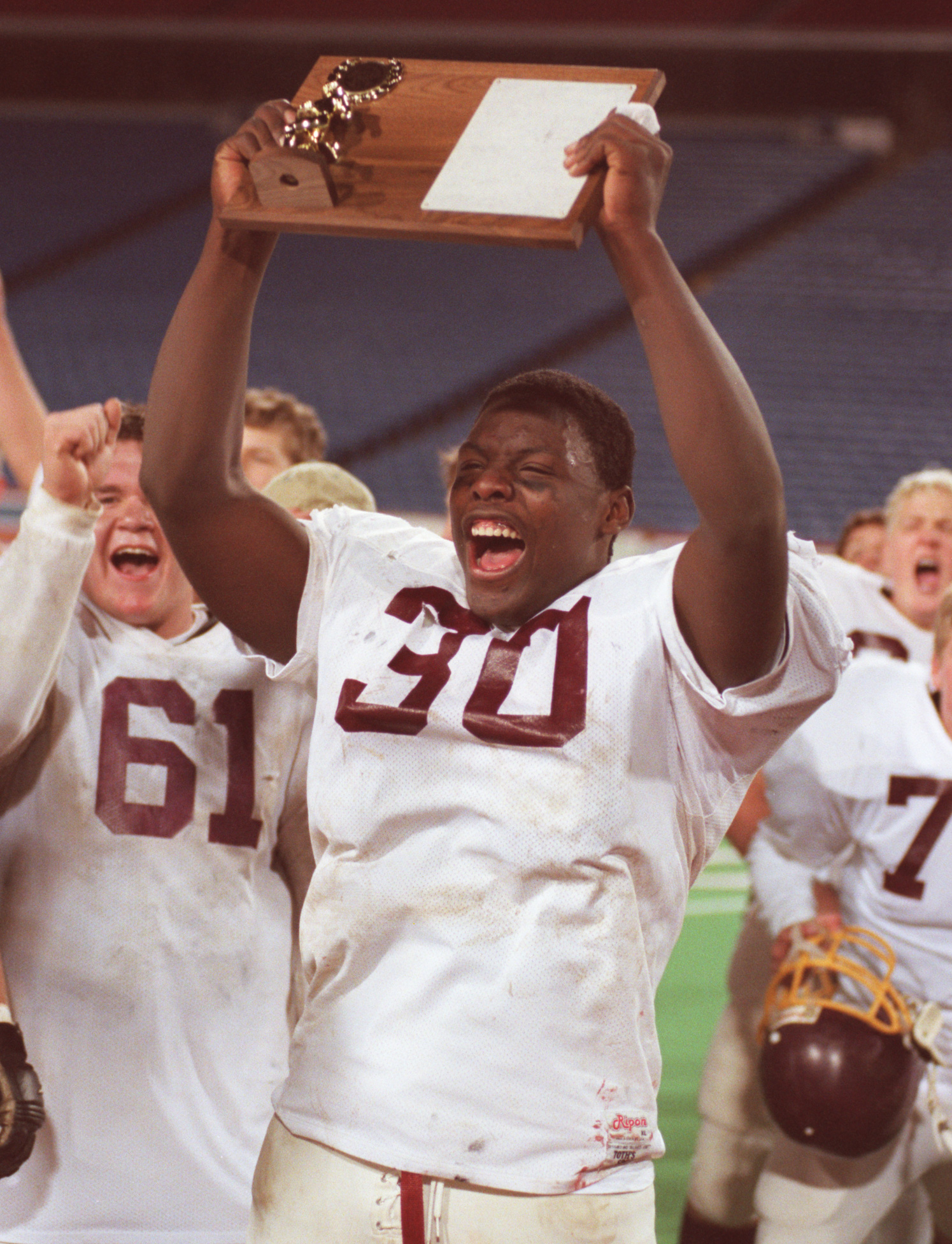 Clymer fullback Jehuu Caulcrick celebrates with teammates after winning the Section VI Class D title at Ralph Wilson Stadium. (Harry Scull Jr./Buffalo News file photo