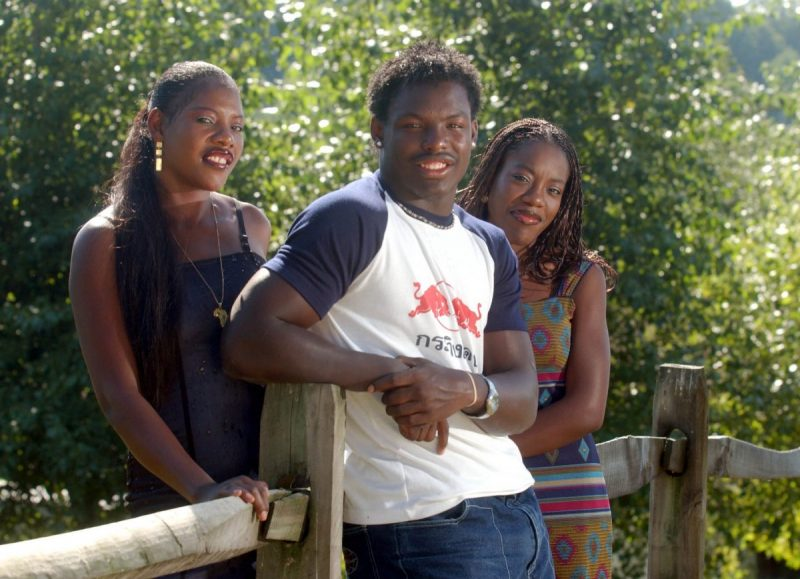 Jehuu Caulcrick at home with his mom Bonita Karo, left, and sister Mardea in August 2002.