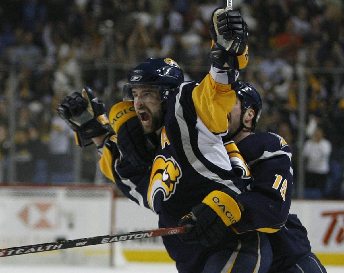 Buffalo's Chris Drury (23) and Tim Connolly (19) celebrate Drury's tying goal with eight seconds left in third period of Game Five against the Rangers on May 4, 2007, at HSBC Arena. (Mark Mulville/Buffalo News file photo)