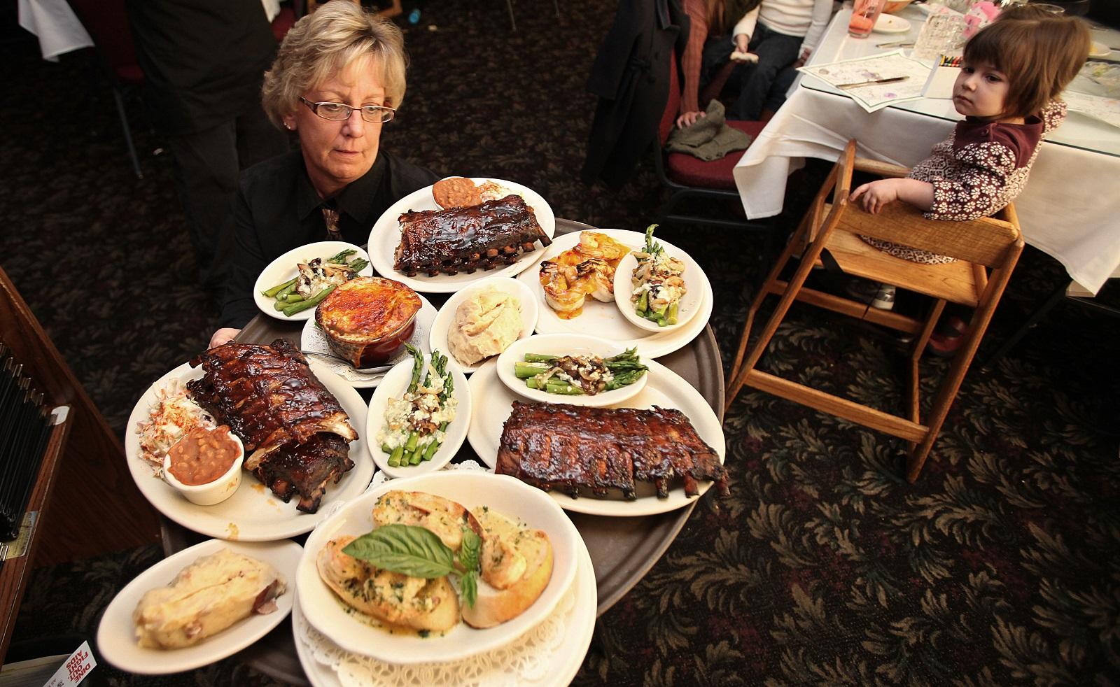 Server Shirley Franz handles a massive platter of food at Hideaway Grille in North Tonawanda. (Buffalo News file photo)
