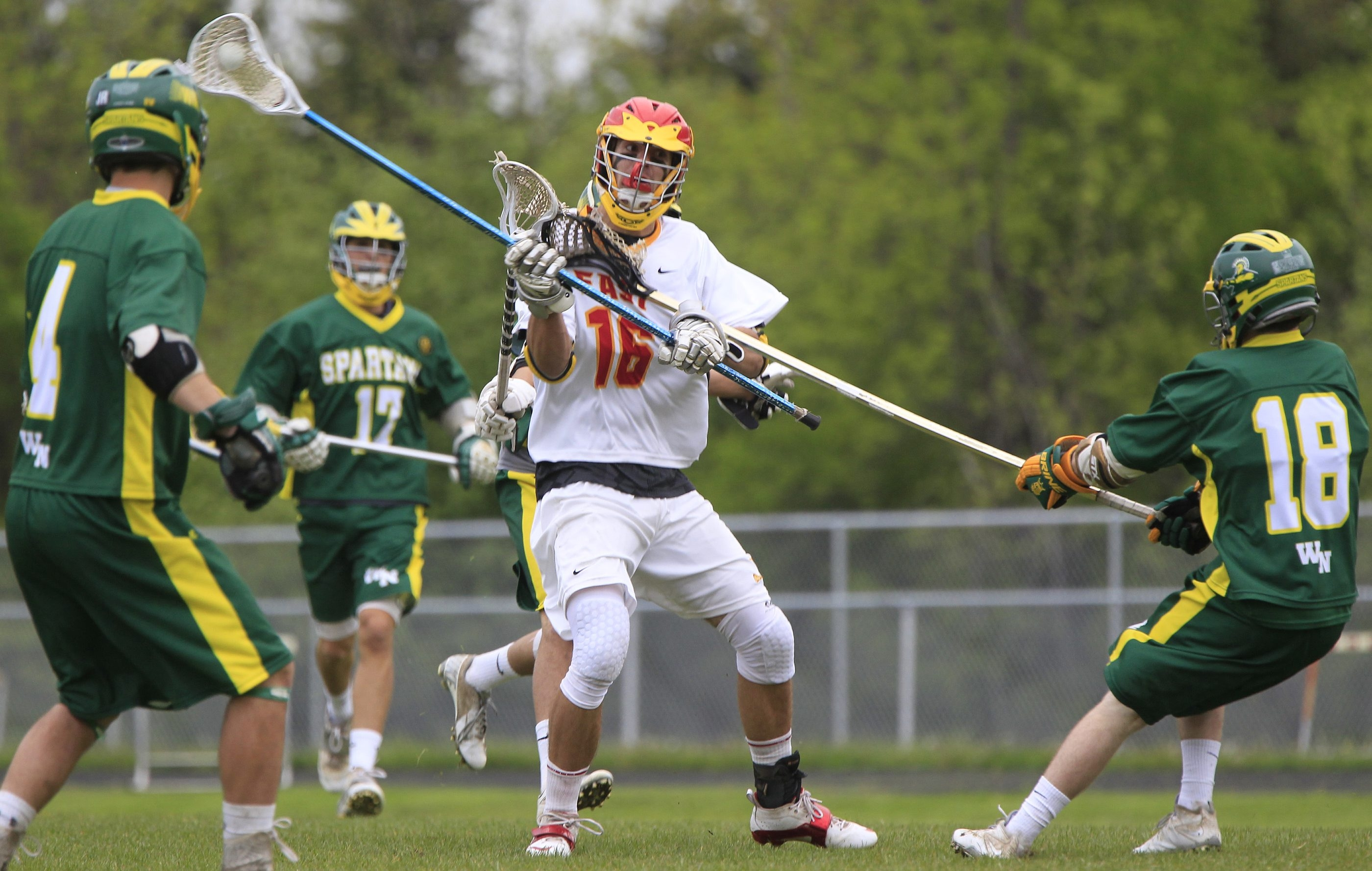 Williamsville East's Blake Rickan, middle, is a US Lacrosse Academic All-American.