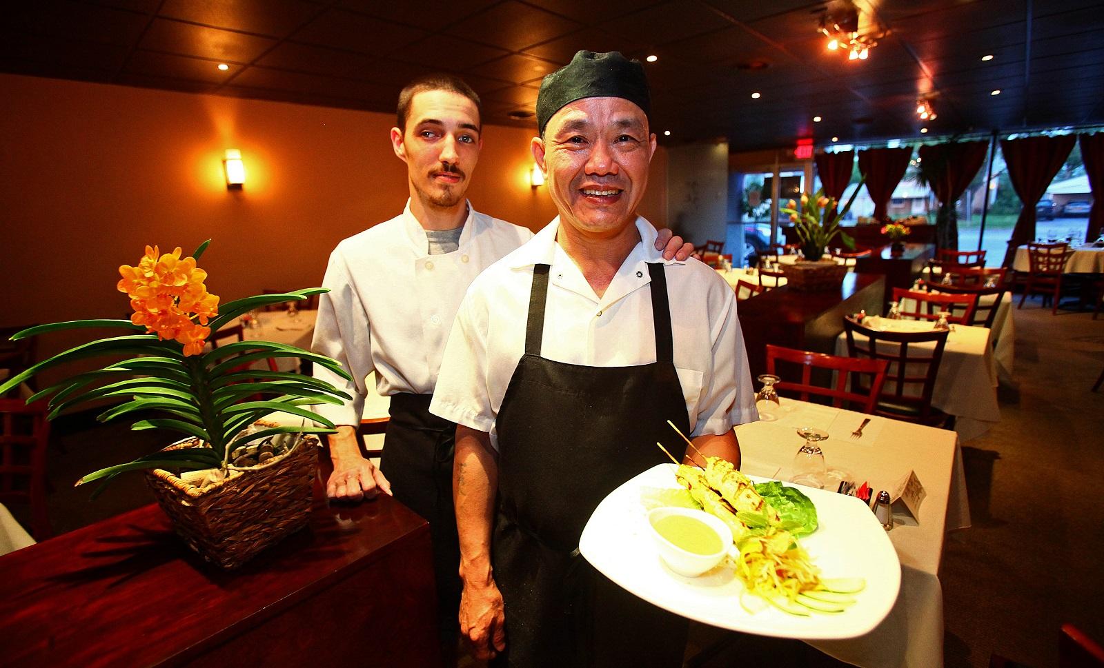 Saigon Bangkok chef Thai Pham, right, with chicken satay, and appetizer chef Kevin Moore, left. (Robert Kirkham/Buffalo News)