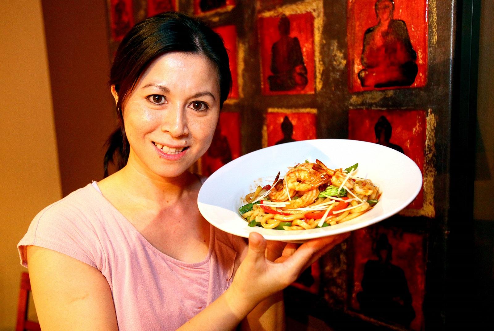 Saigon Bangkok's Anna Truong with basil shrimp udon at said restaurant on Niagara Falls Boulevard in the Town of Tonawanda. (Robert Kirkham/Buffalo News)