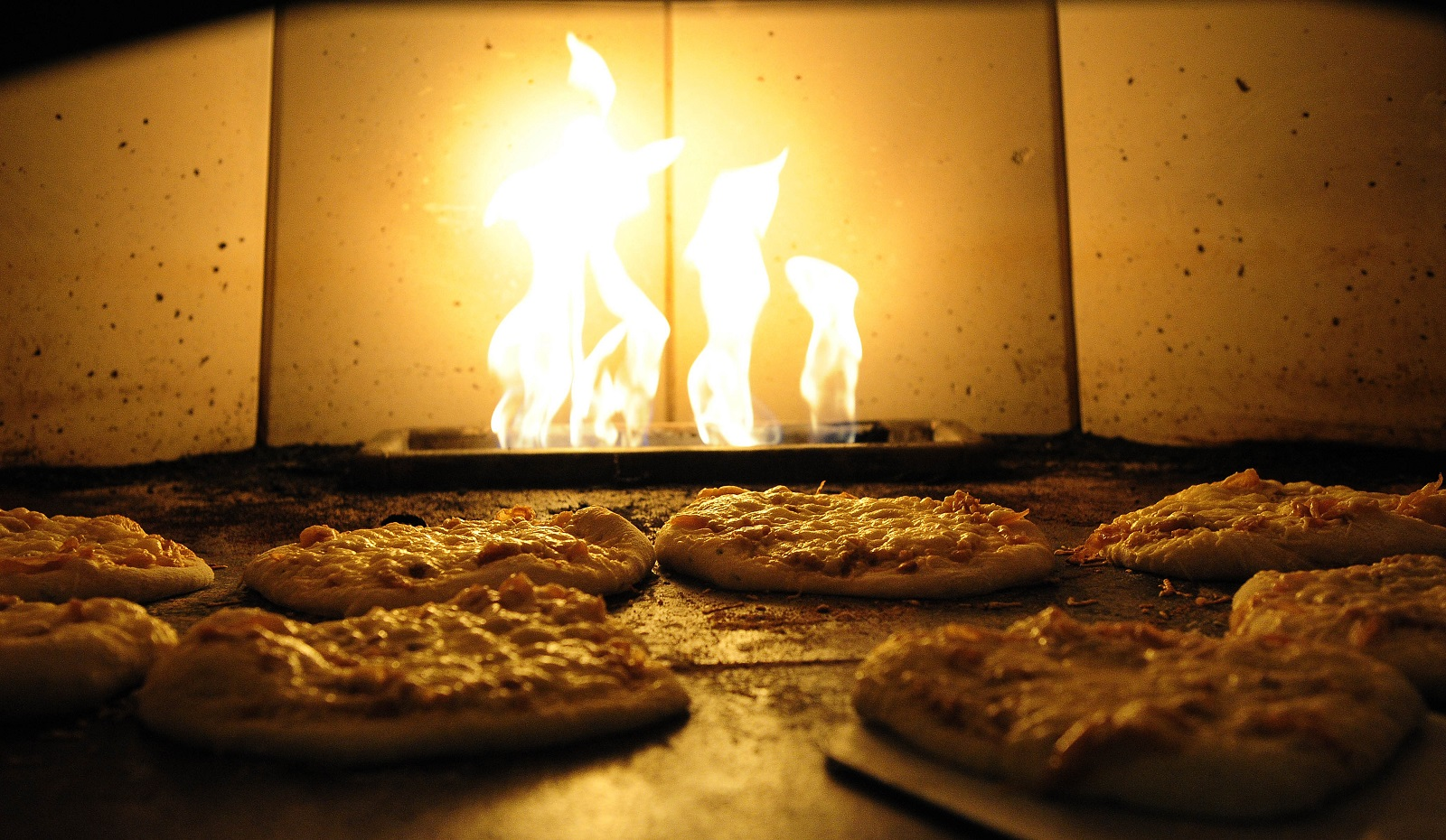 Pizzas cook in the scorching hot oven. (Buffalo News file photo)