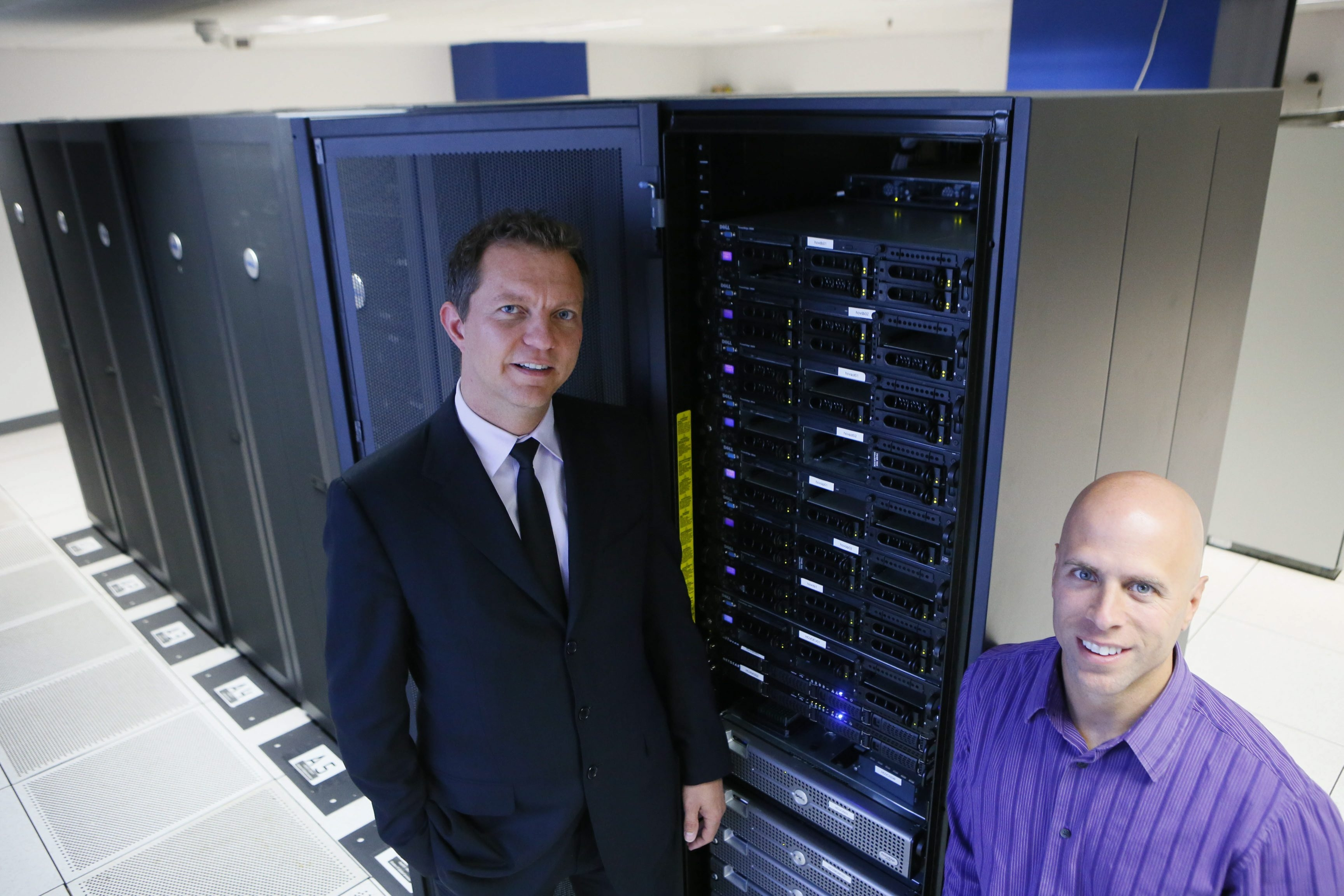 Hover Networks co-founders Sean Hus Var, left, and Darren Ascone, stand inside the server room at Shatter I.T. Hover Networks has about 350 clients, including Perry's Ice Cream, Dunn Tire and Hunt Real Estate.