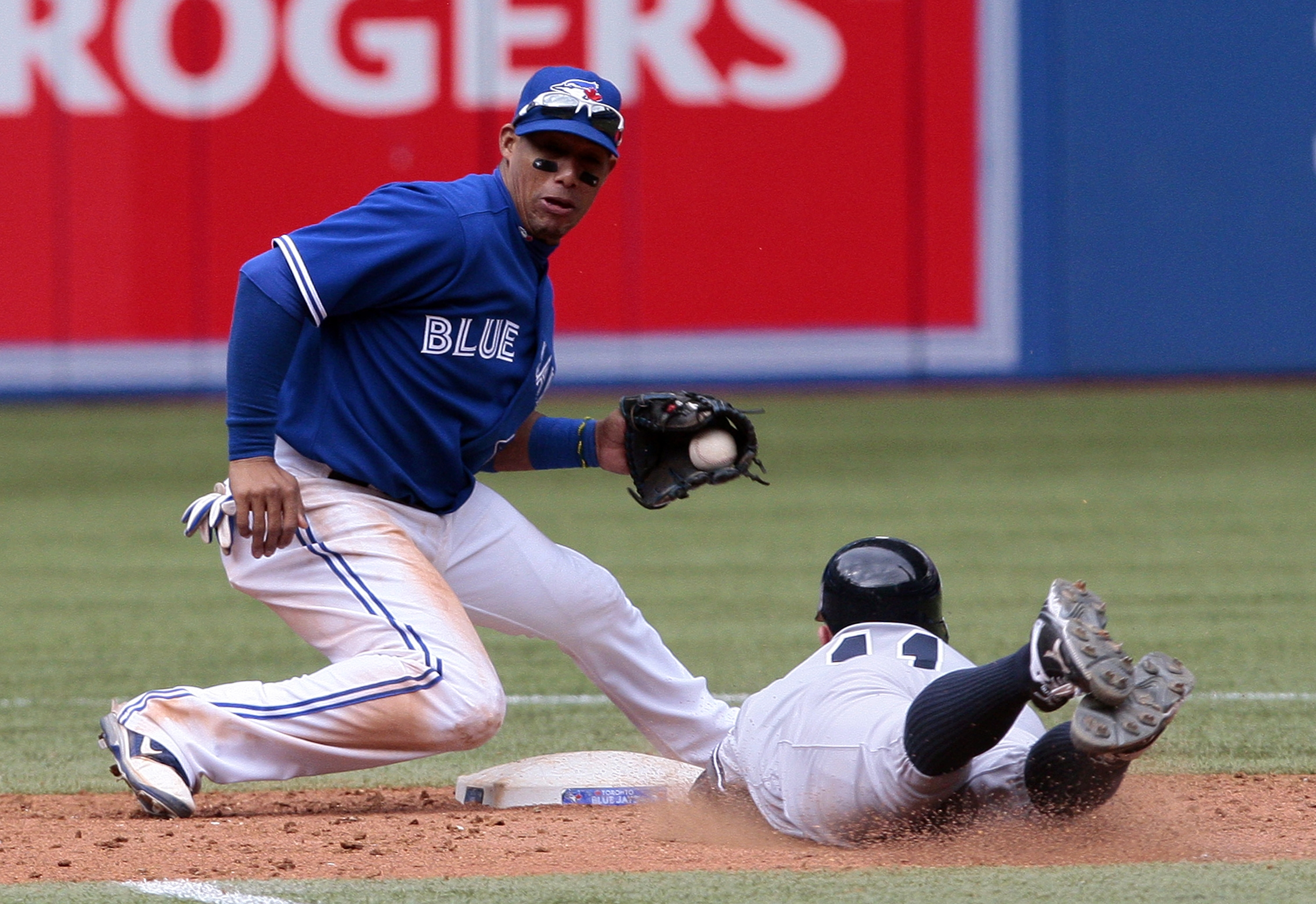 Getty Images    Toronto's Yunel Escobar fields the throw before tagging Brett Gardner of the Yankees on a steal attempt in the eighth inning Saturday.