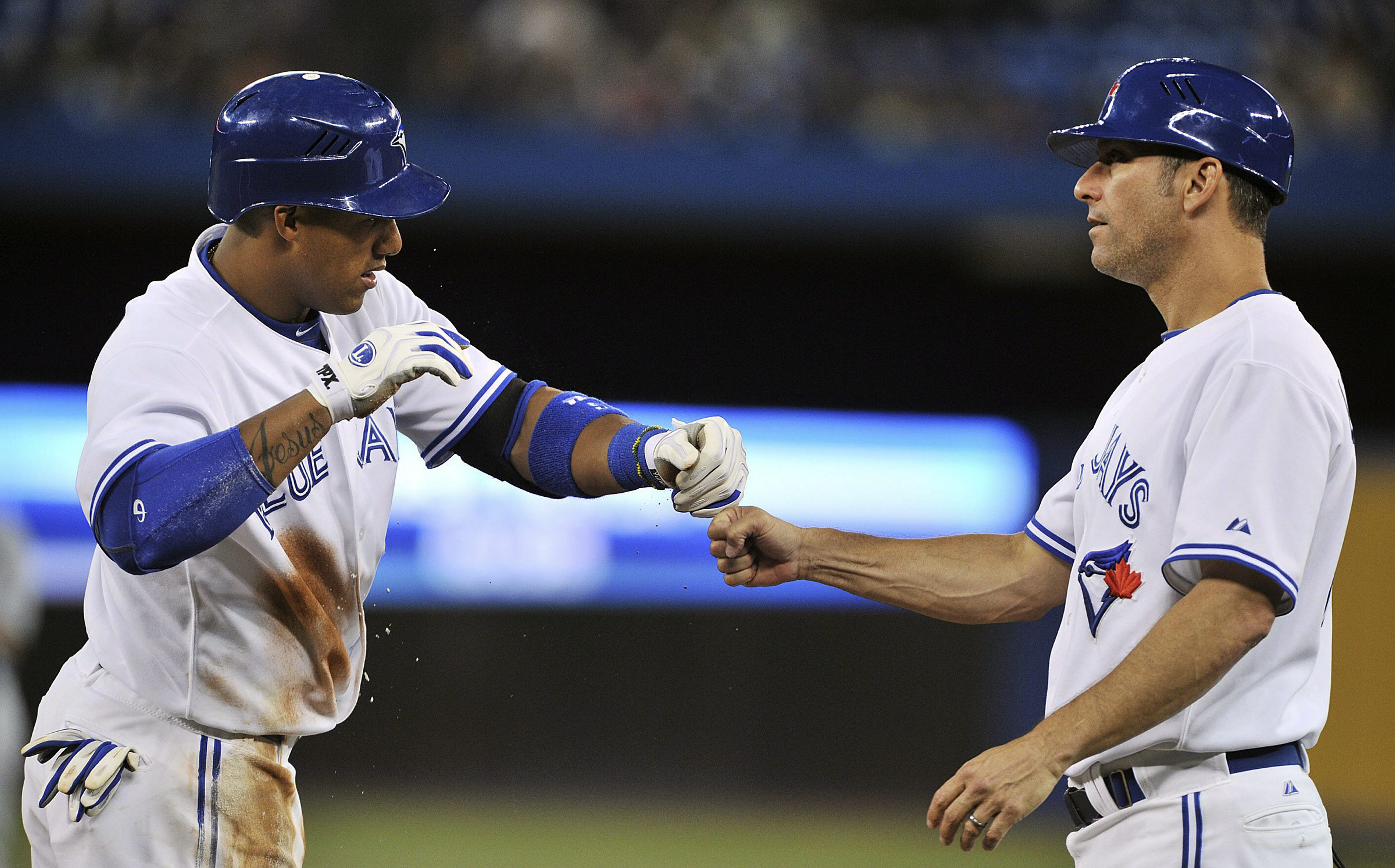 Associated Press    The Toronto Blue Jays' Yunel Escobar, left, celebrates a single with first base coach Torey Lovullo.