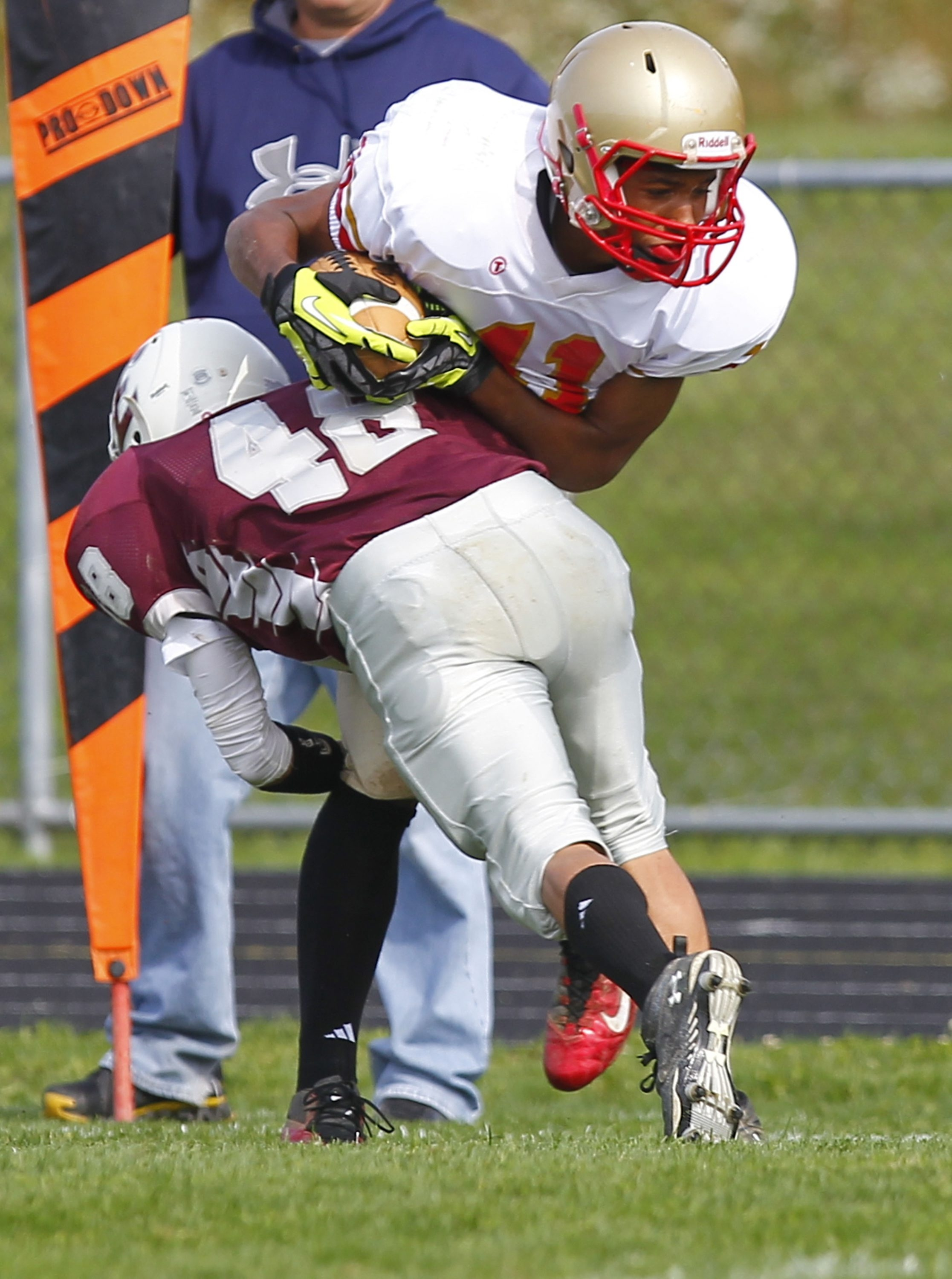 John Hickey / Buffalo News    Olean receiver Wil Bathurst absorbs a hit by Eden's Kevin Delia during the Huskies' 28-14 win at No. 9 small school Eden.