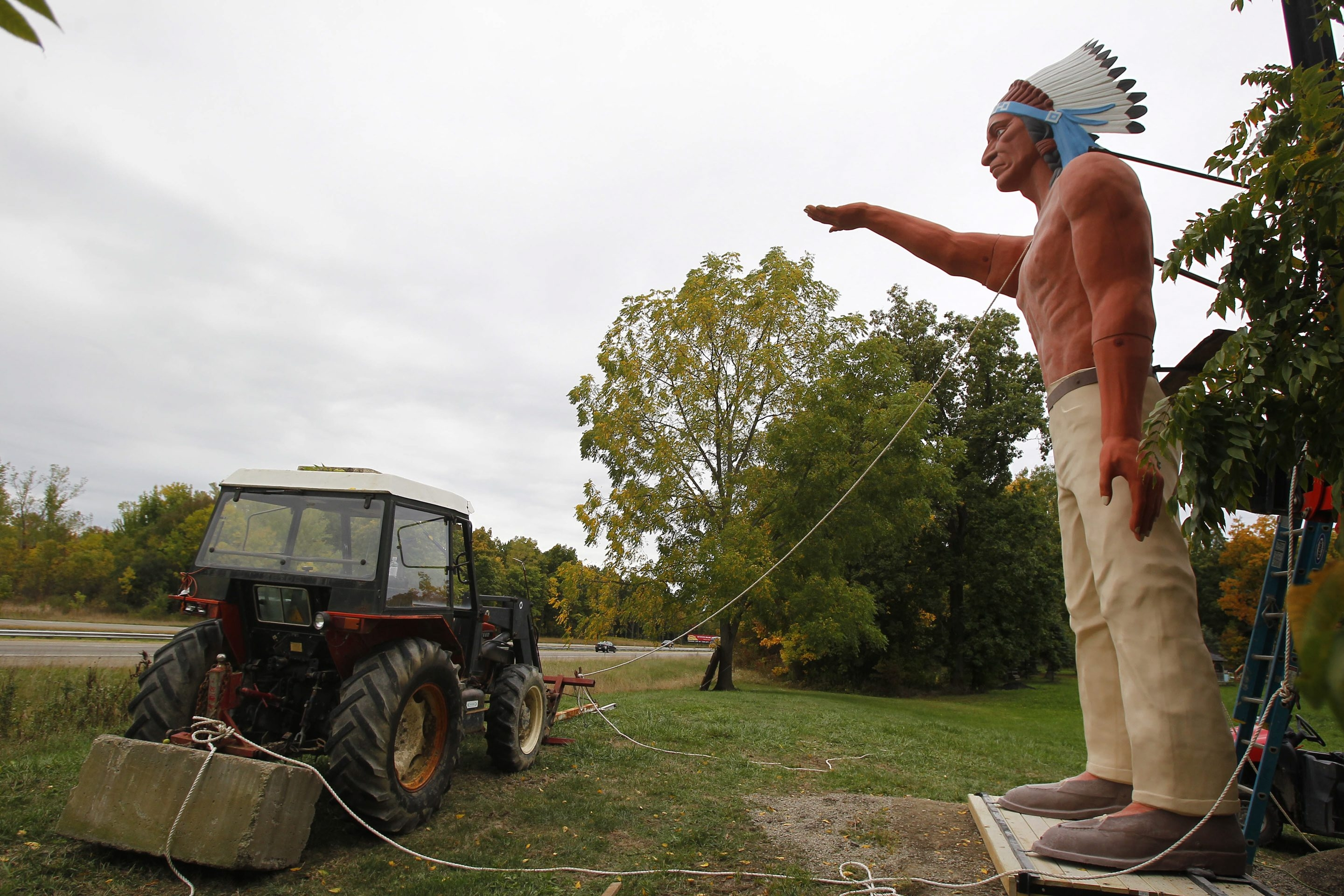 Mark Mulville/Buffalo News    The 'Big Indian' is returned to his perch overlooking the Thruway in Irving. The 28-foot-tall statue had been taken down after being badly damaged by vandals in June.