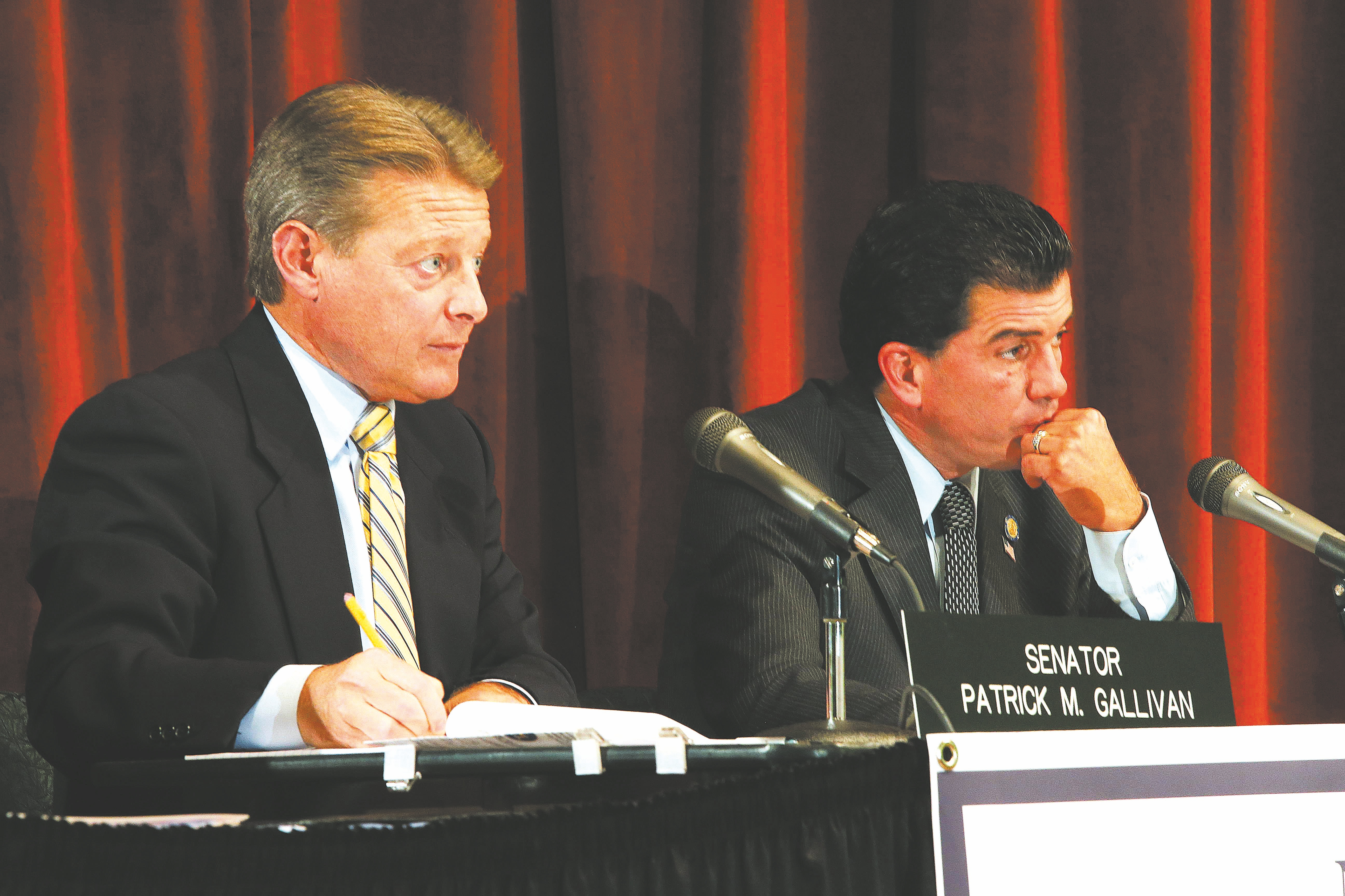 Robert Kirkham/Buffalo News    State Sens. Patrick M. Gallivan, left, and Mark J. Grisanti listen to testimony during a hearing at Central Library on possible reforms to IDA system for economic development.
