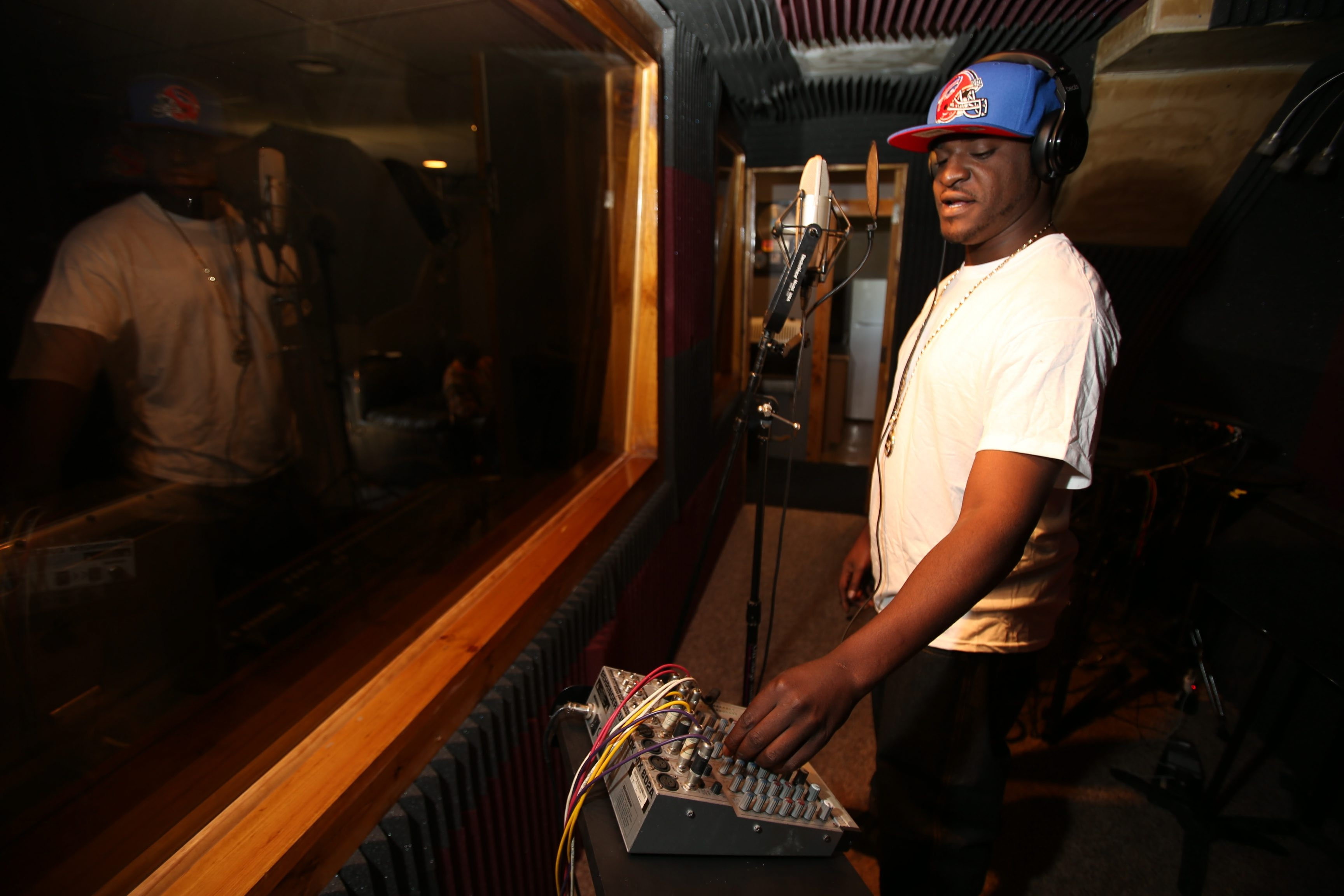 Charles Lewis/Buffalo News     Raycel Brown, in the Buffalo studio where he records, will perform Saturday for Black Entertainment Television's annual Hip-Hop Awards after-party in Atlanta, where he hopes his music will be discovered.