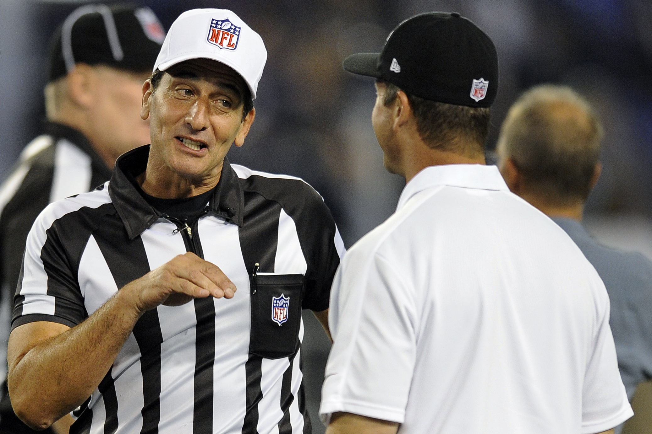 Associated Press    Referee Gene Steratore greets Ravens coach John Harbaugh Thursday.