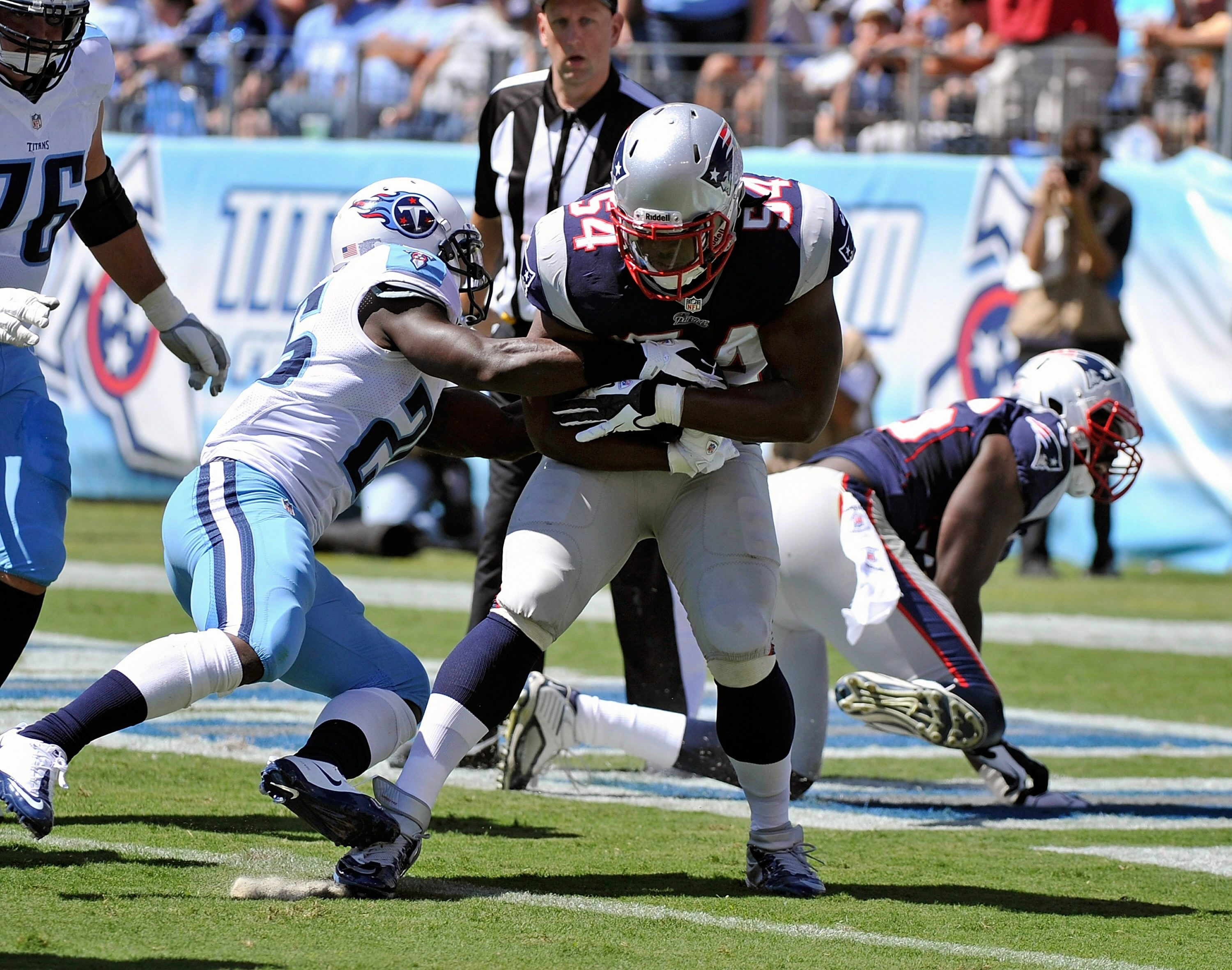 Dont'a Hightower #54 of the New England Patriots scores a touchdown after recovering a fumble against the Tennessee Titans during their season opener in Nashville.  (Photo by Frederick Breedon/Getty Images)