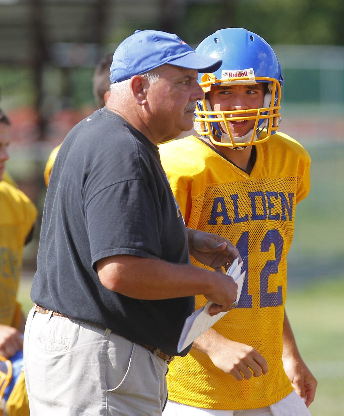 Mark Mulville / Buffalo News    Alden coach Dick Diminuco and quarterback Brian Stoldt aim for another win over Depew.