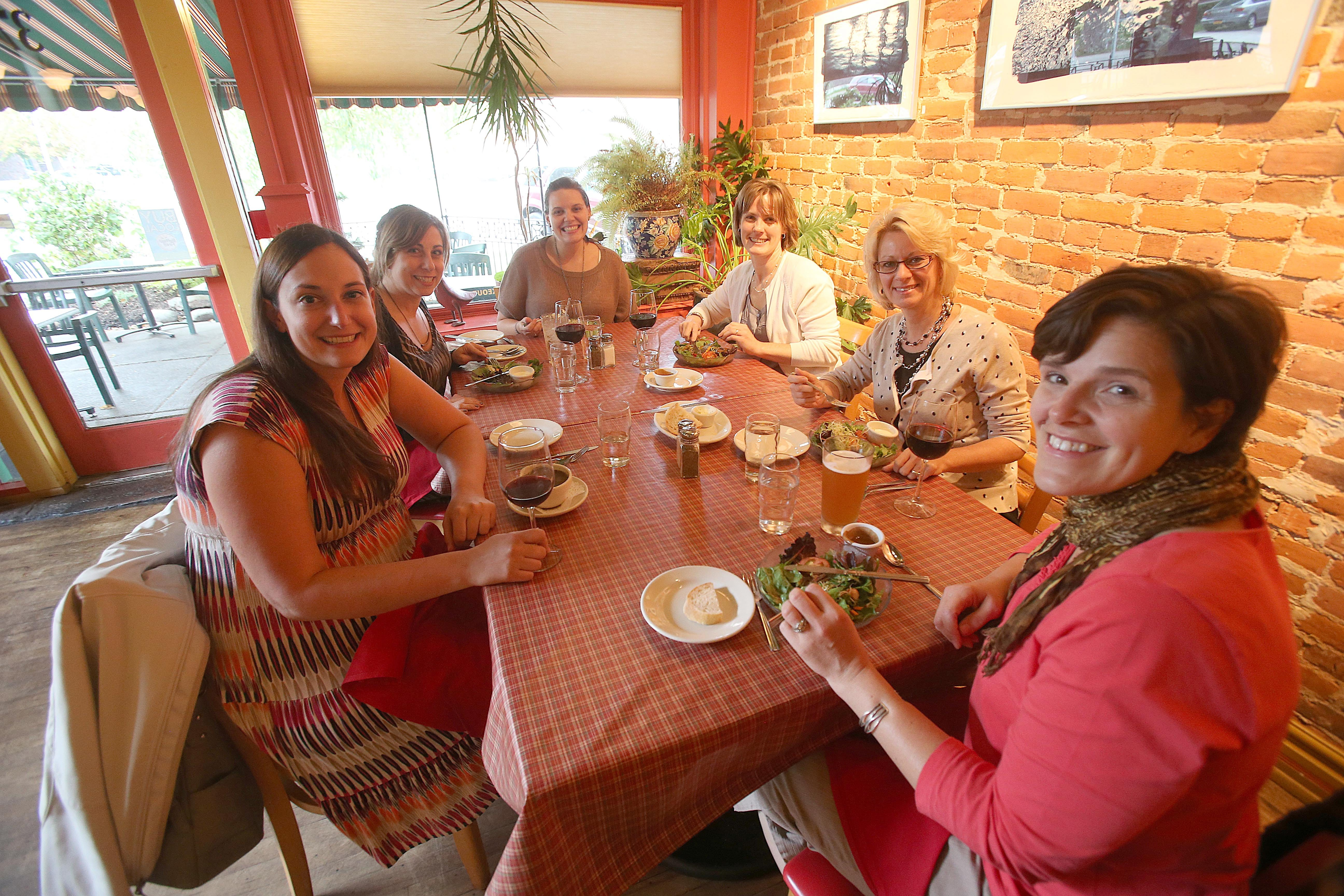 Photos by Robert Kirkham/Buffalo News    A group of women enjoy dinner and drinks at Betty's before going to a show at Shea's Performing Arts Center.