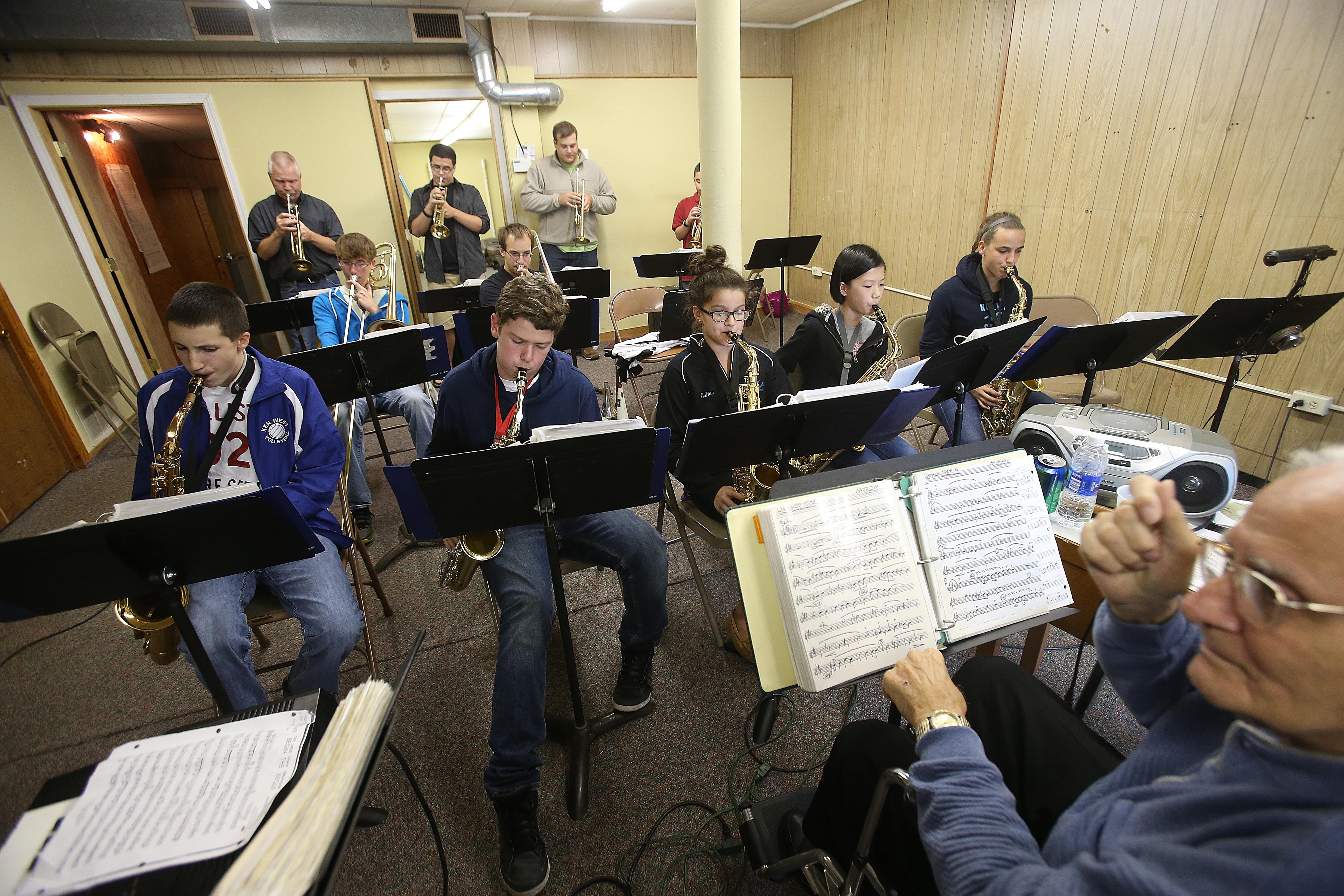Under the direction of Frank Lorango, bottom right, young members of the Sugar & Jazz Band rehearse in North Tonawanda. Sax players from left are Christopher Dymond, 17, Zach Jabine, 14, Gillian Scozzaro, 12, Helen Huang, 12, and Emily Belote, 16.  {Photo by Robert Kirkham / Buffalo News}