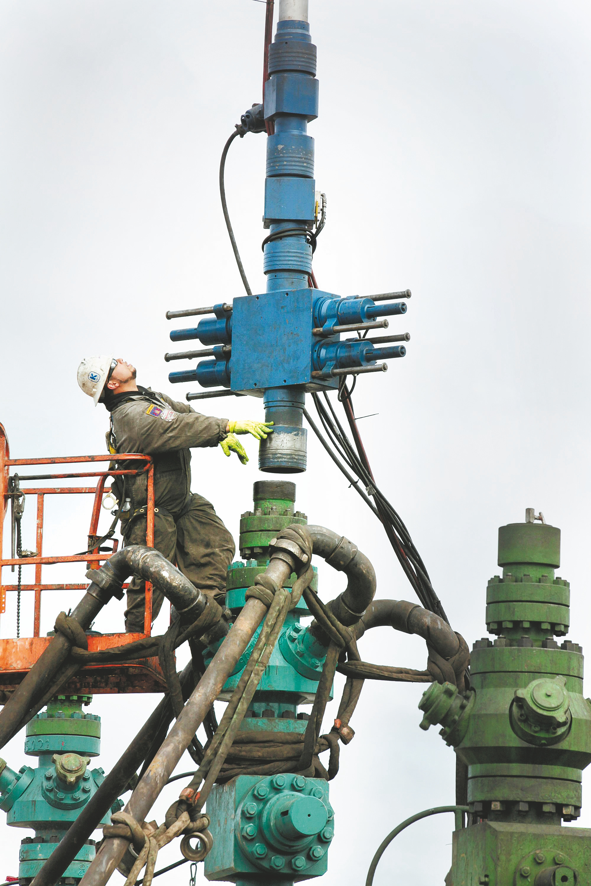 Bloomberg News    A worker cleans and lubricates the head of a hydraulic fracturing machine in Camptown, Pa.