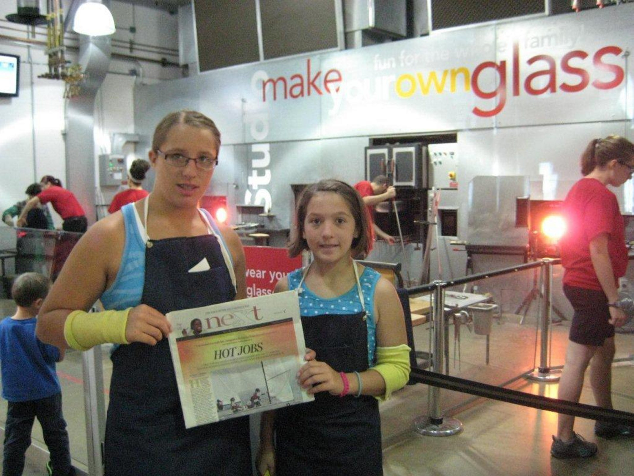 While camping in the Finger Lakes, Amber Carls, right, an eighth-grader, and her sister, Sarah, a seventh-grader at Edward Town Middle School in the Niagara Wheatfield School District, took NeXt along on a day trip to a glass-making class in Corning.
