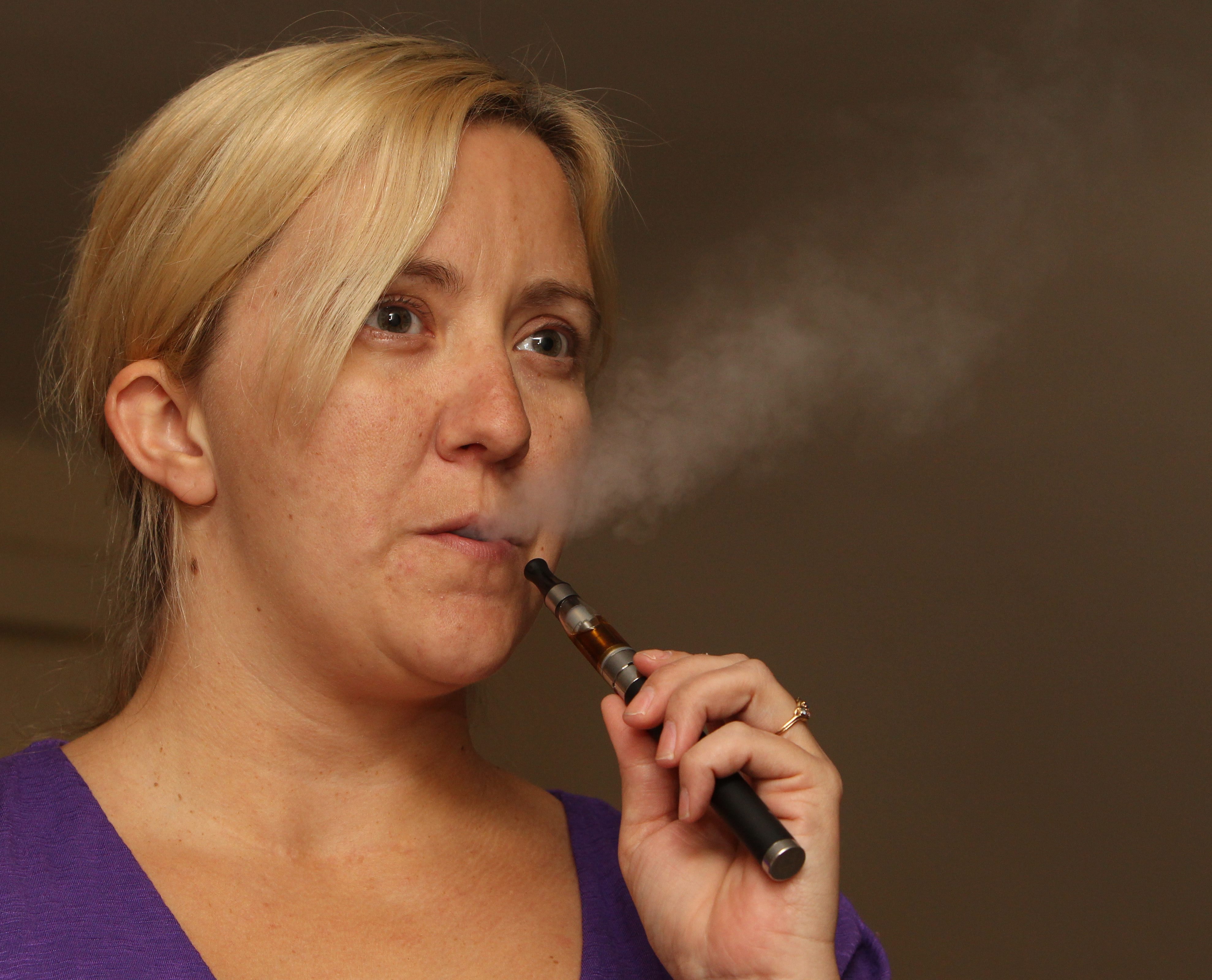 James P. McCoy/Buffalo News    'You just hit it whenever you get the urge,'  Kelly Randles said of e-cigarettes.