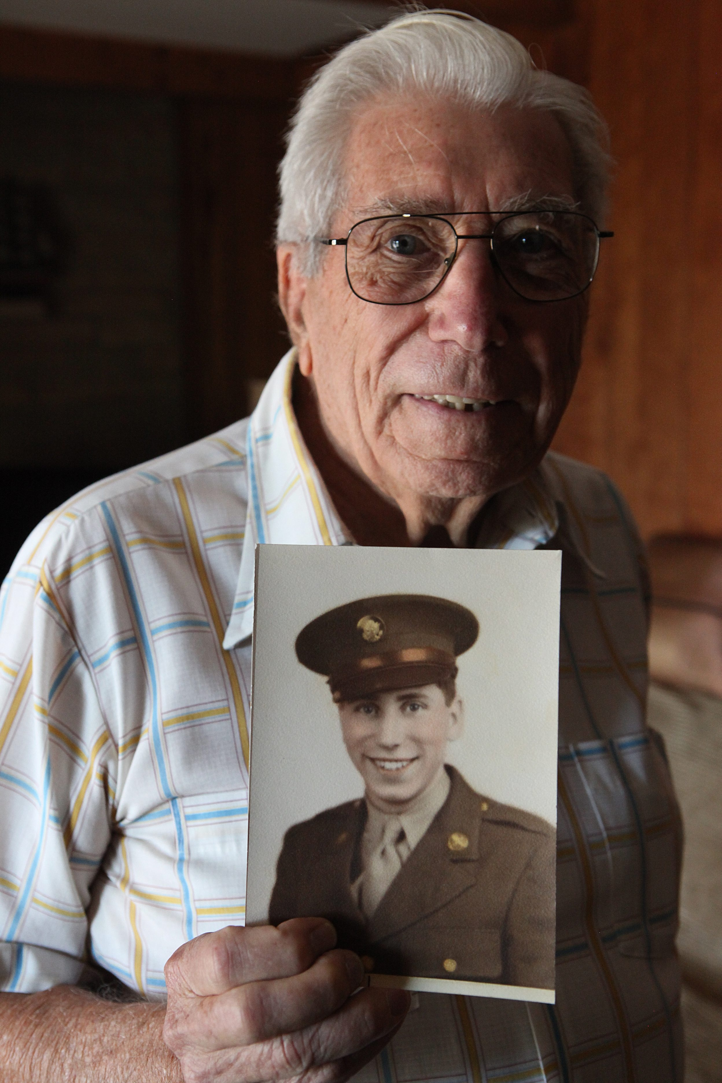 Charles Lewis/Buffalo News    Carl Clemen is thankful that he and his fellow crew members avoided enemy fire on B-29 bombing missions over Tokyo and other Japanese cities.