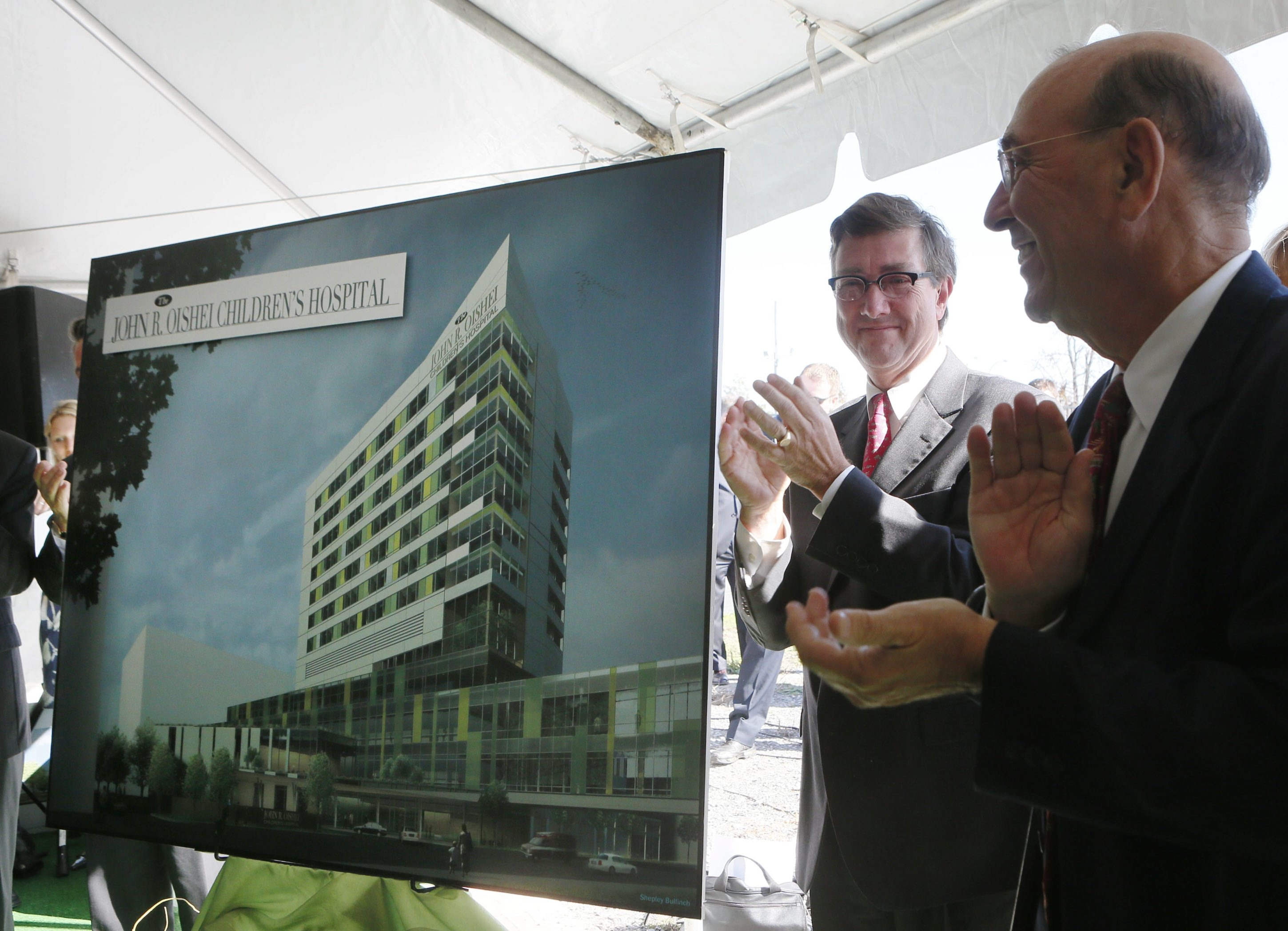 Kaleida Health CEO James R. Kaskie, left, and John R. Oishei Foundation Chairman James M. Wadsworth stand next to an artist's rendering of the new John R. Oishei Children's Hospital during a ceremony at the planned site. (Derek Gee / Buffalo News)