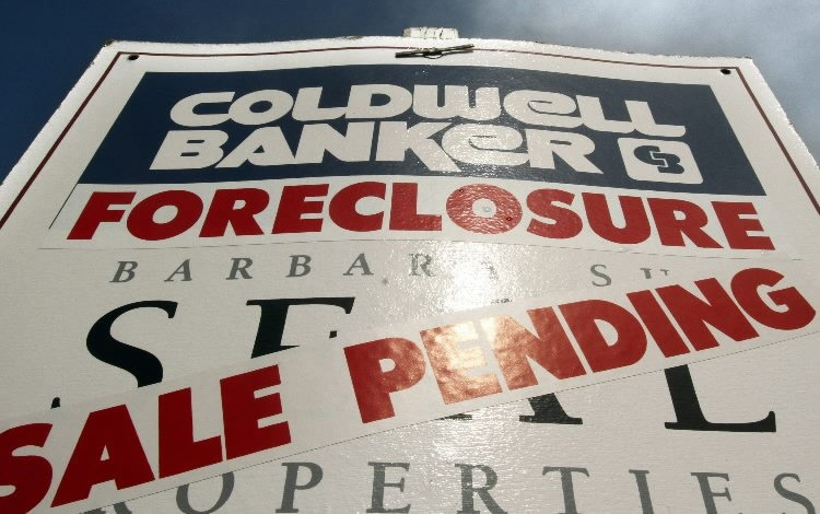 Associated Press file photo shows a foreclosed house with sale pending sign. New York Attorney General Eric Scnheiderman announced Monday new funding for foreclosure prevention efforts in the state.