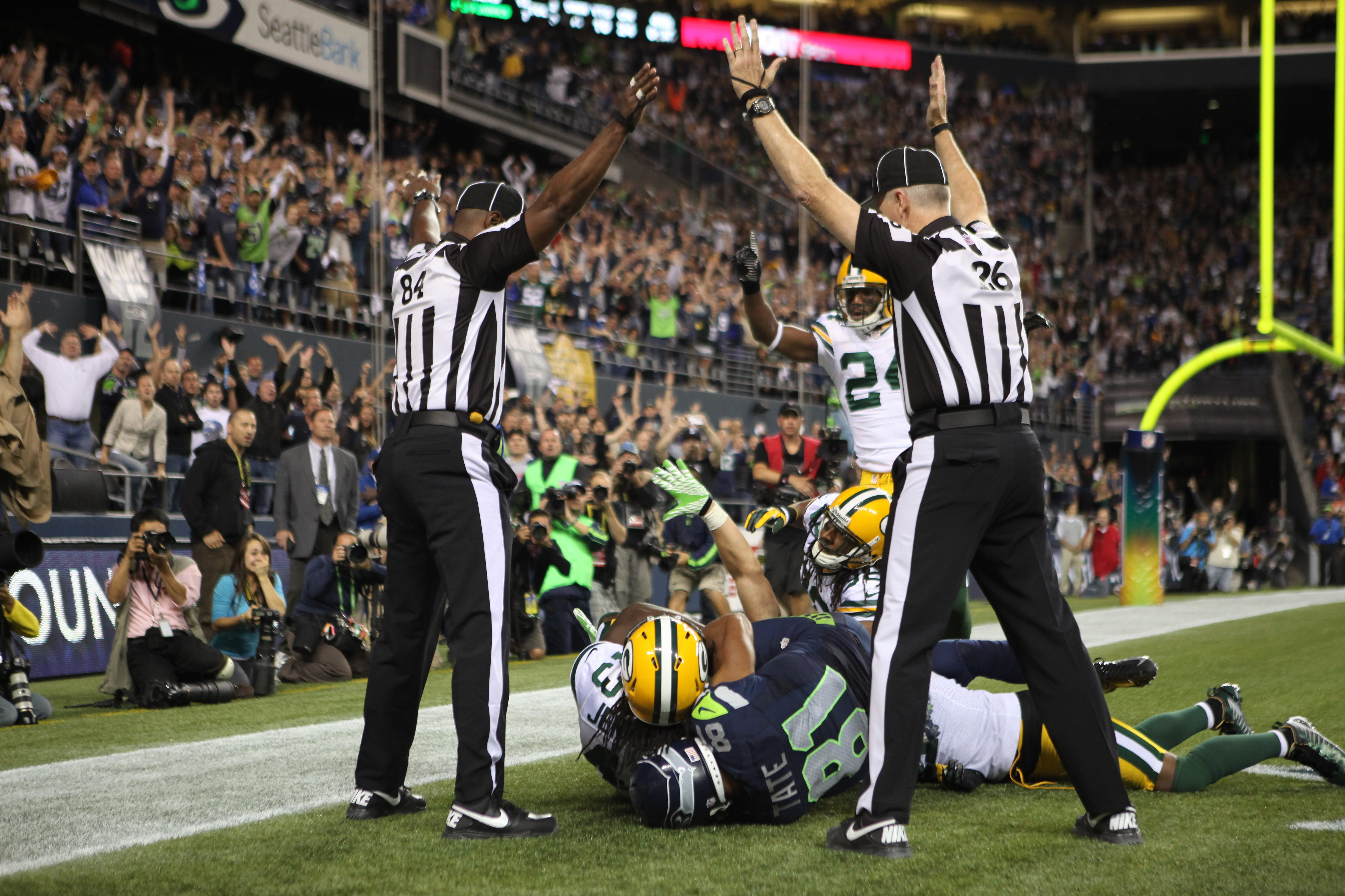 Officials in the end zone on the last play in Monday night's game called the play differently. The ruling on the field awarded Seattle receiver Golden Tate a touchdown for a simultaneous catch. (Getty Images)