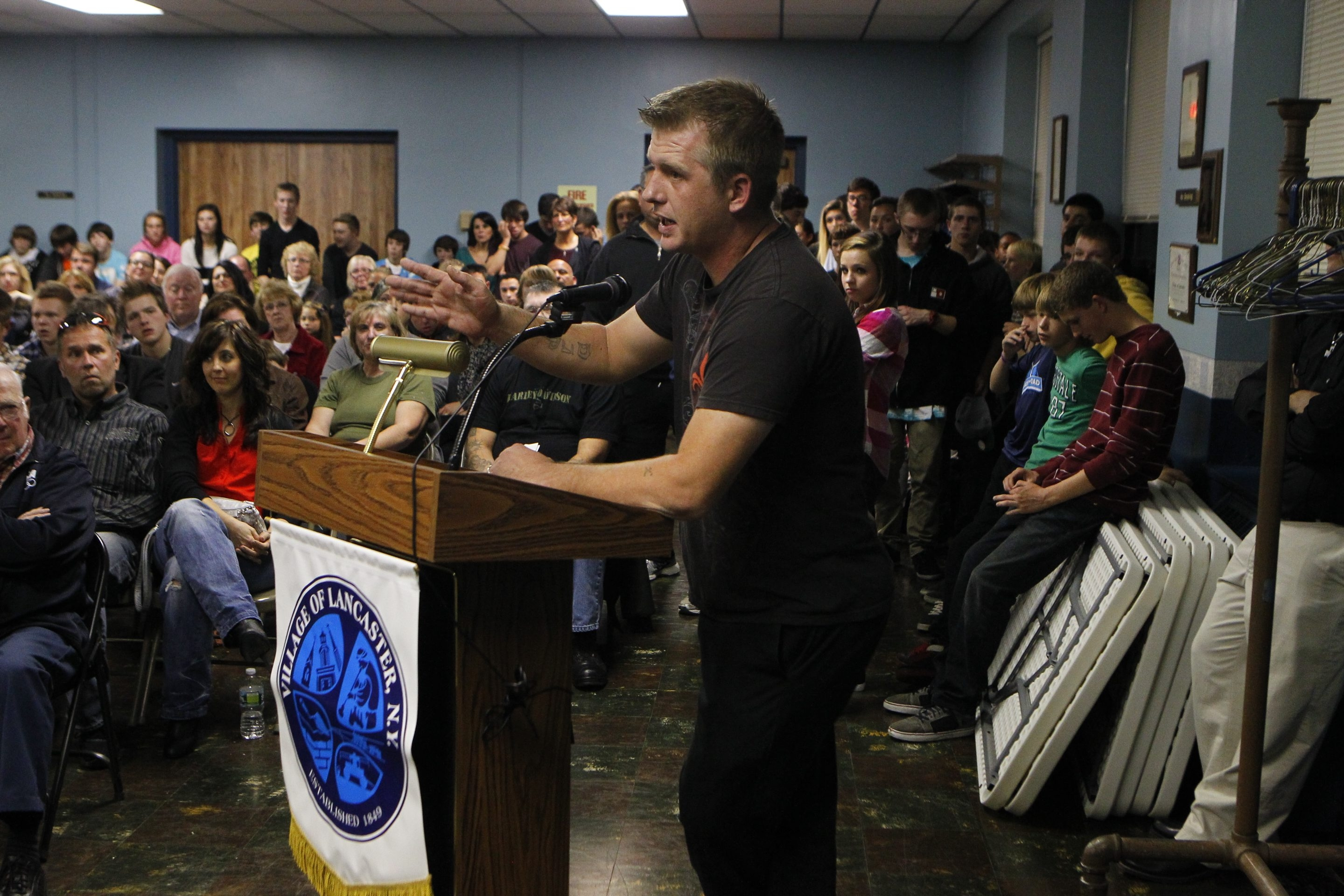 John Hickey/Buffalo News    Dan Prichard, owner of Sirens Skateshop, speaks Monday night at the Lancaster Village Board meeting.