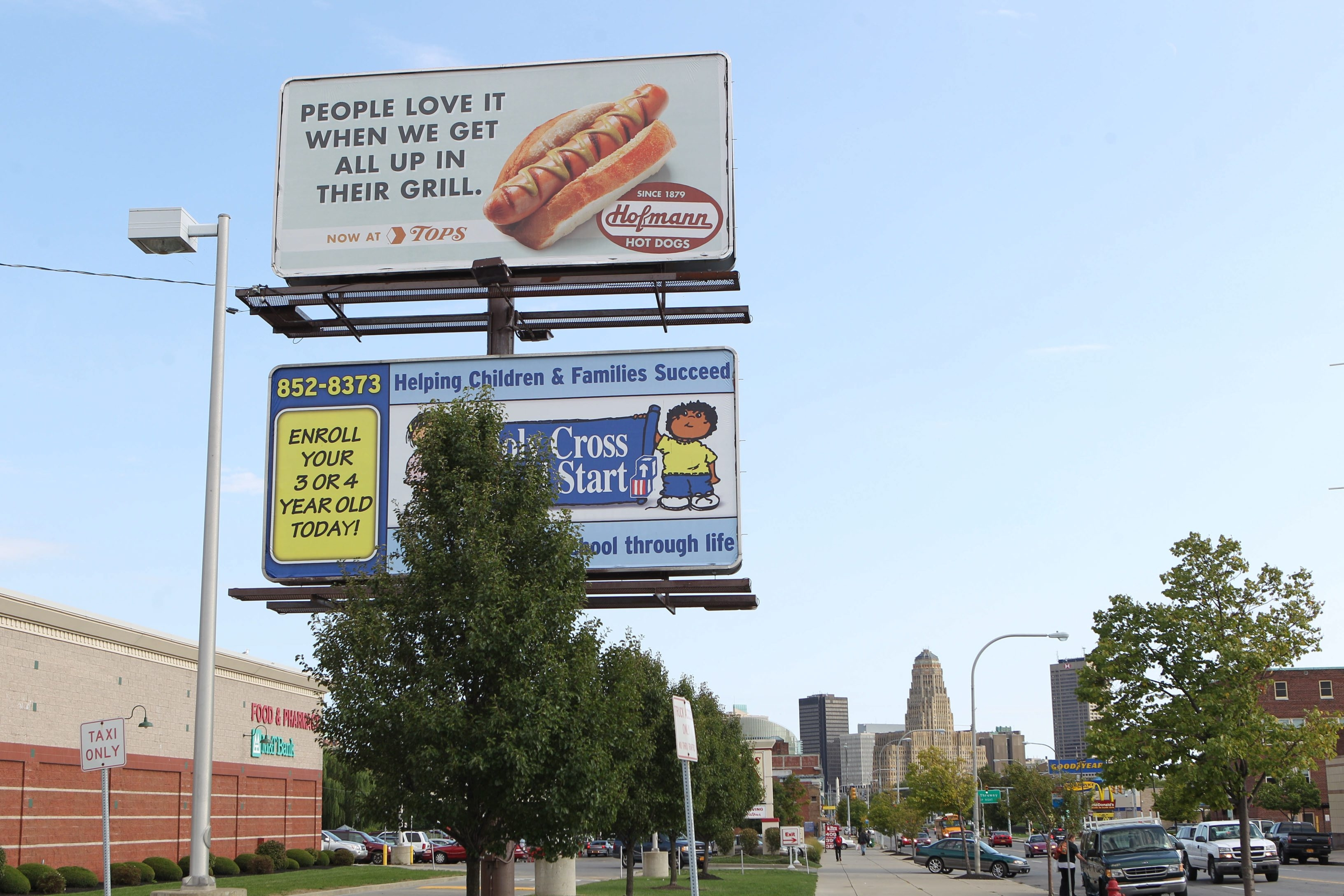 Sharon Cantillon/Buffalo News     A billboard overlooking Niagara Street in Buffalo advertises Hofmann hot dogs. The popular Central New York brand is moving into the Western New York market.