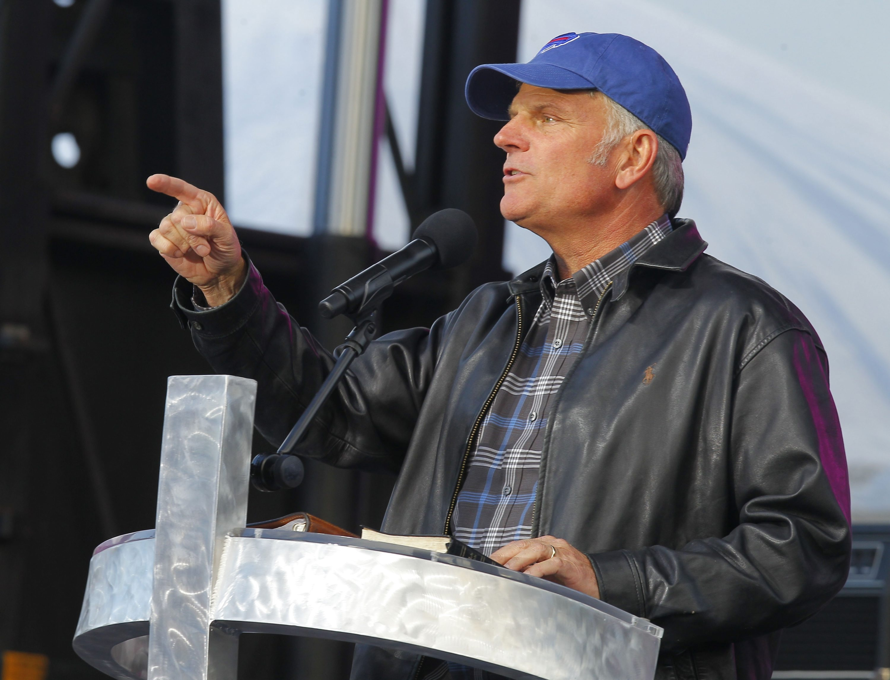 The Rev. Franklin Graham, wearing a Bills cap, tells the crowd about his commitment to Christ, and asks them to follow his lead.  John Hickey/Buffalo News