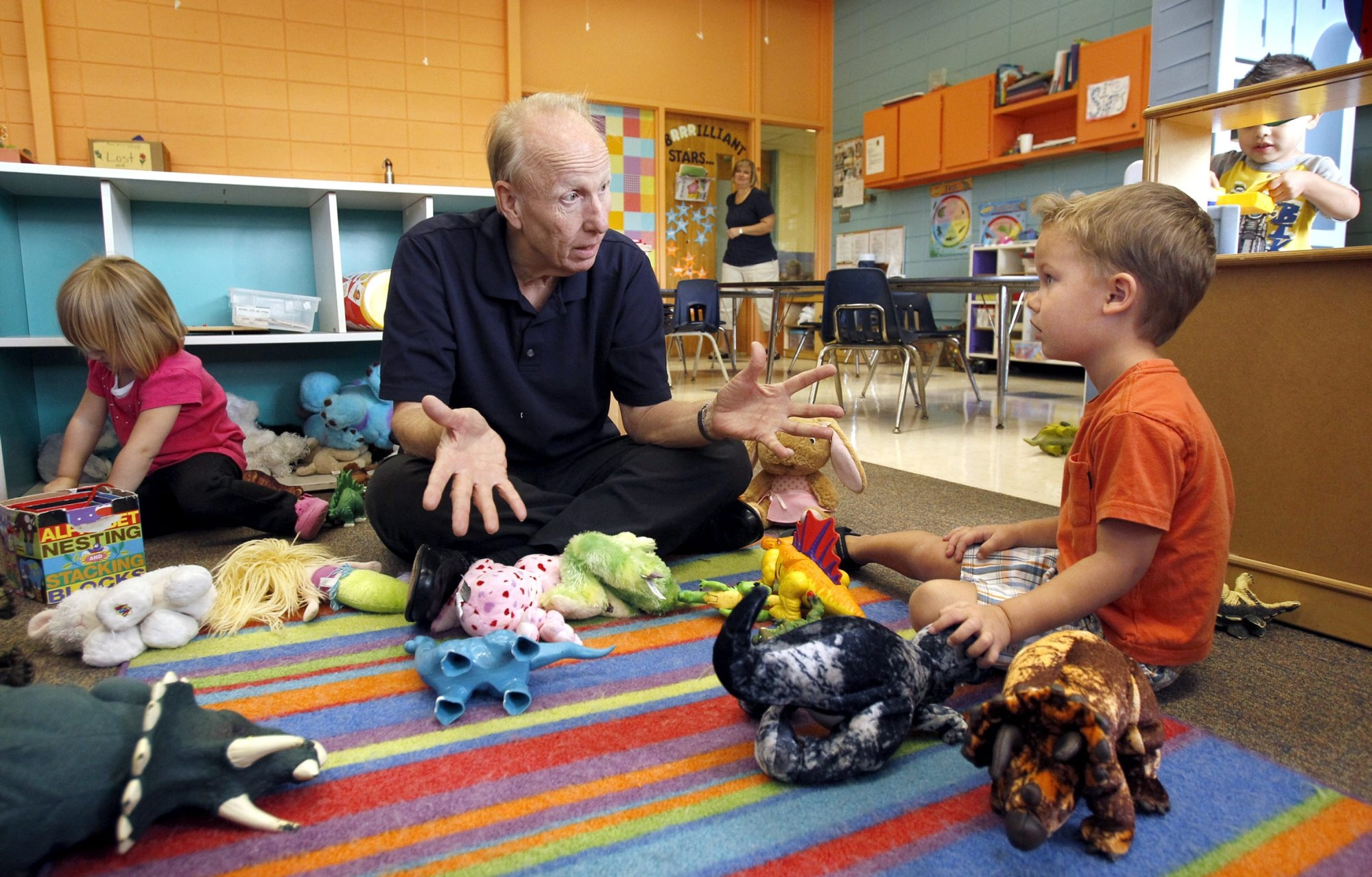 McClatchy Newspapers    Bill Brockman landed a post-retirement job at the Village Church Child and Family Development Center in Overland Park, Kan., where his duties include playing with the kids.