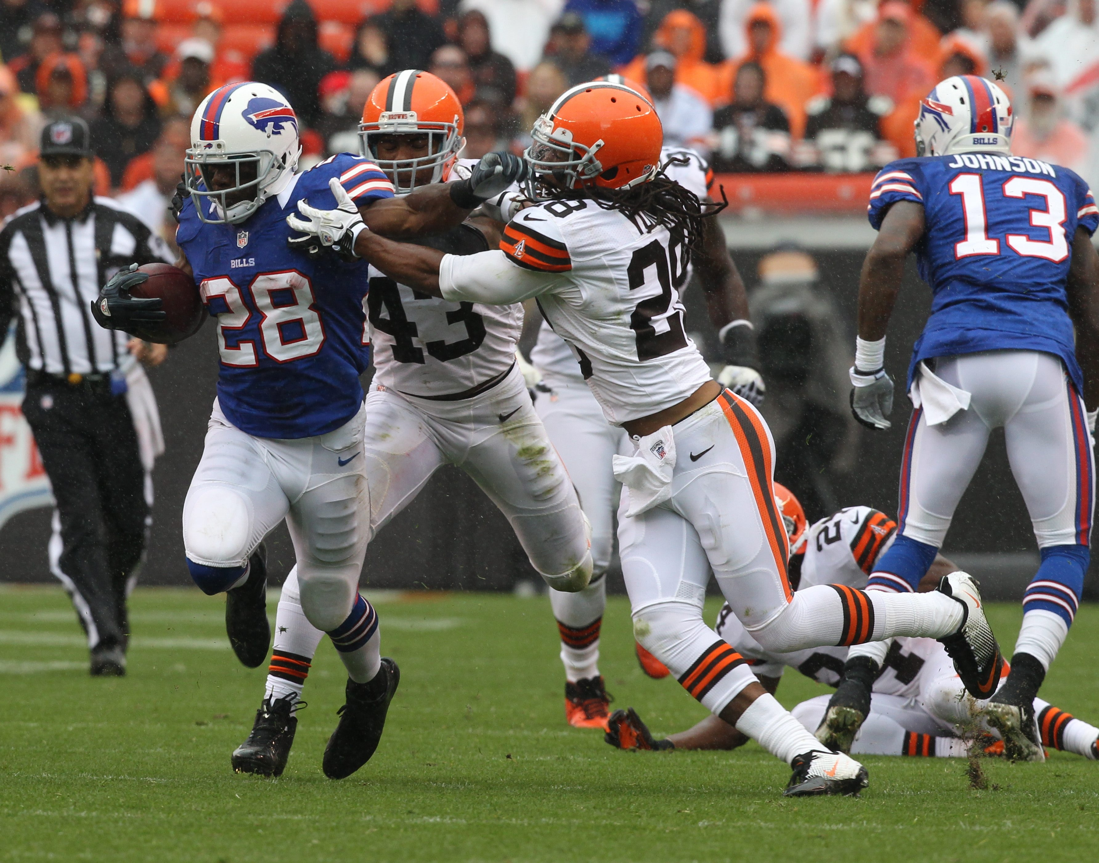 James P. McCoy / Buffalo News    Bills running back C.J. Spiller gets tackled by Cleveland Browns strong safety Usama Young in the first quarter. Spiller hurt a shoulder on the play and did not return.