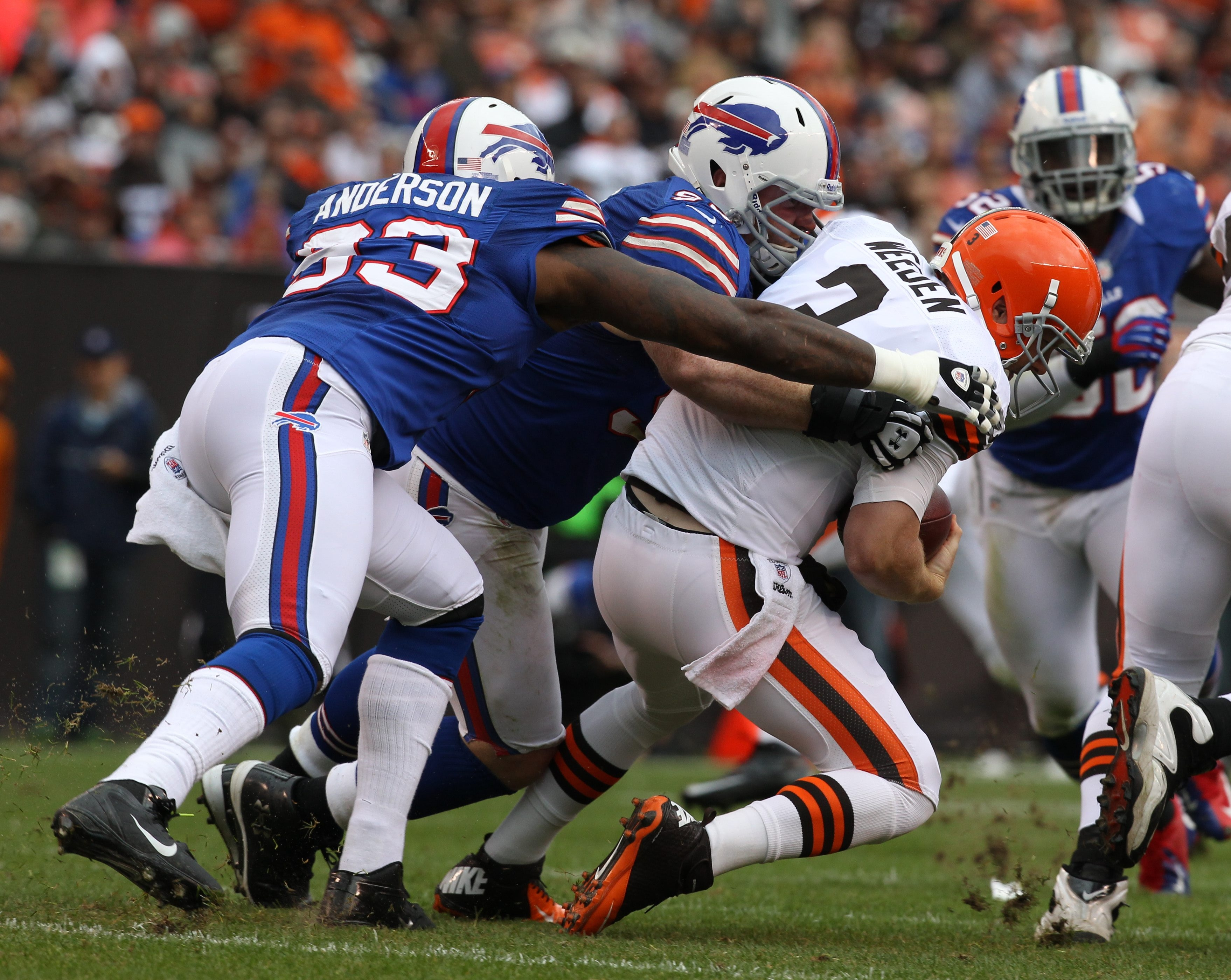 James P. McCoy / Buffalo News  Tackle Kyle Williams gets the first of four sacks of Browns quarterback Brandon Weeden by the Bills' defense.