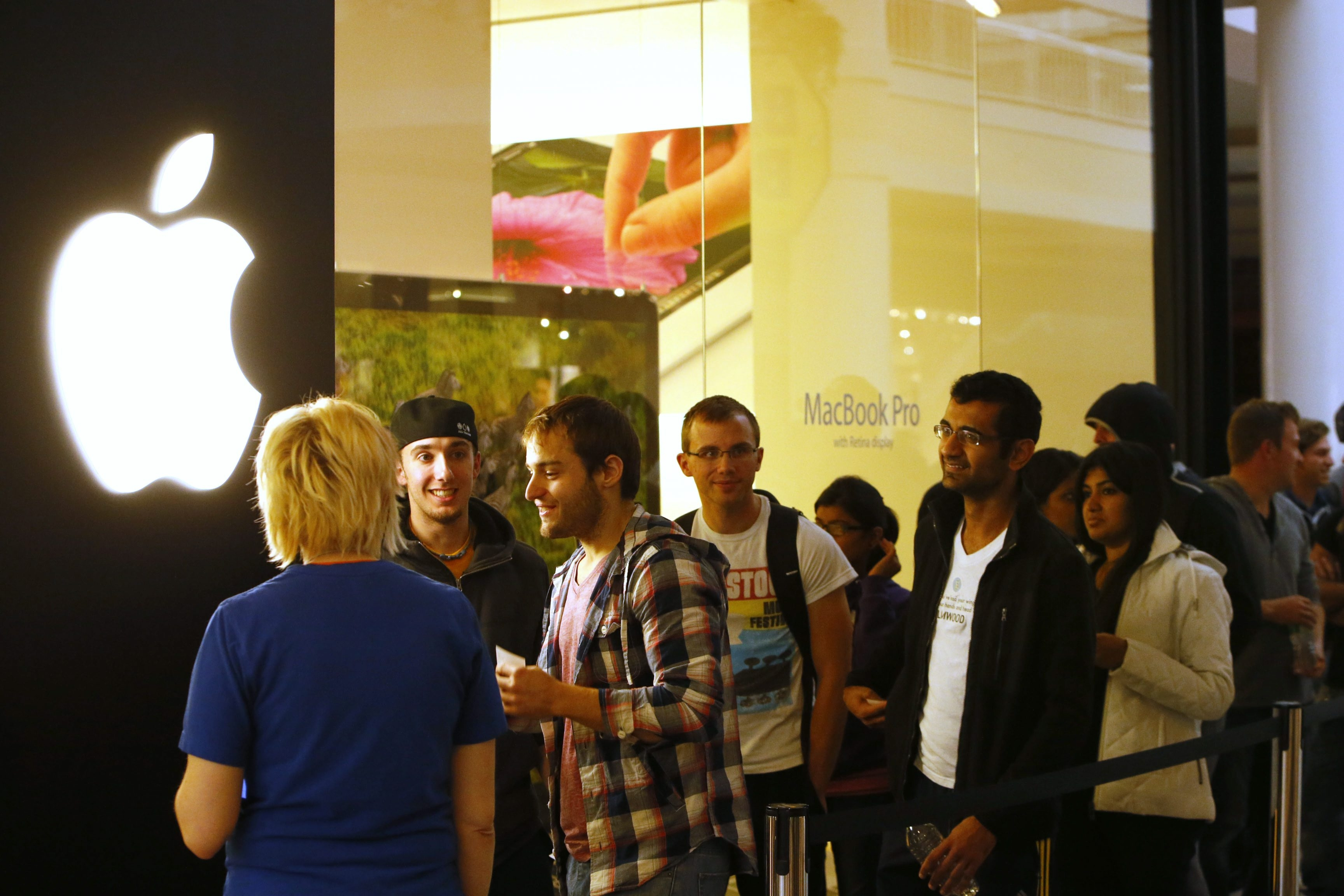 Derek Gee/Buffalo News    Apple enthusiasts wait in line outside the Apple Store at the Walden Galleria early Friday  purchase the new iPhone 5. Some of the more patient fans waited as long as eight hours.