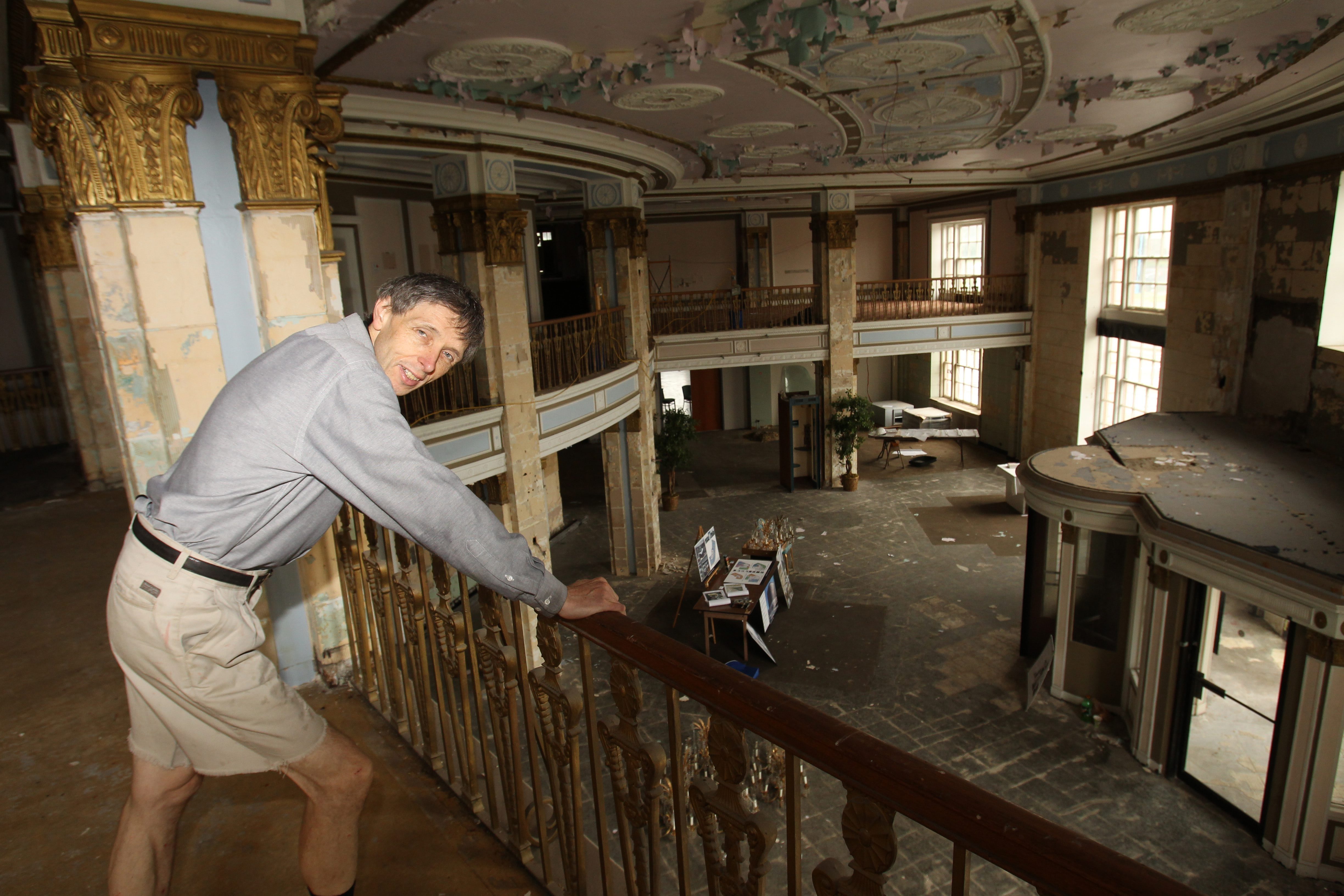 James P. McCoy/Buffalo News    Harry Stinson, described by a Canadian magazine as 'Toronto's answer to Donald Trump,' surveys the lobby of vacant Hotel Niagara amid plans to have a Getzville firm restore it. 'Condo King' considers his project to renovate the downtown landmark 'an enormous opportunity.'