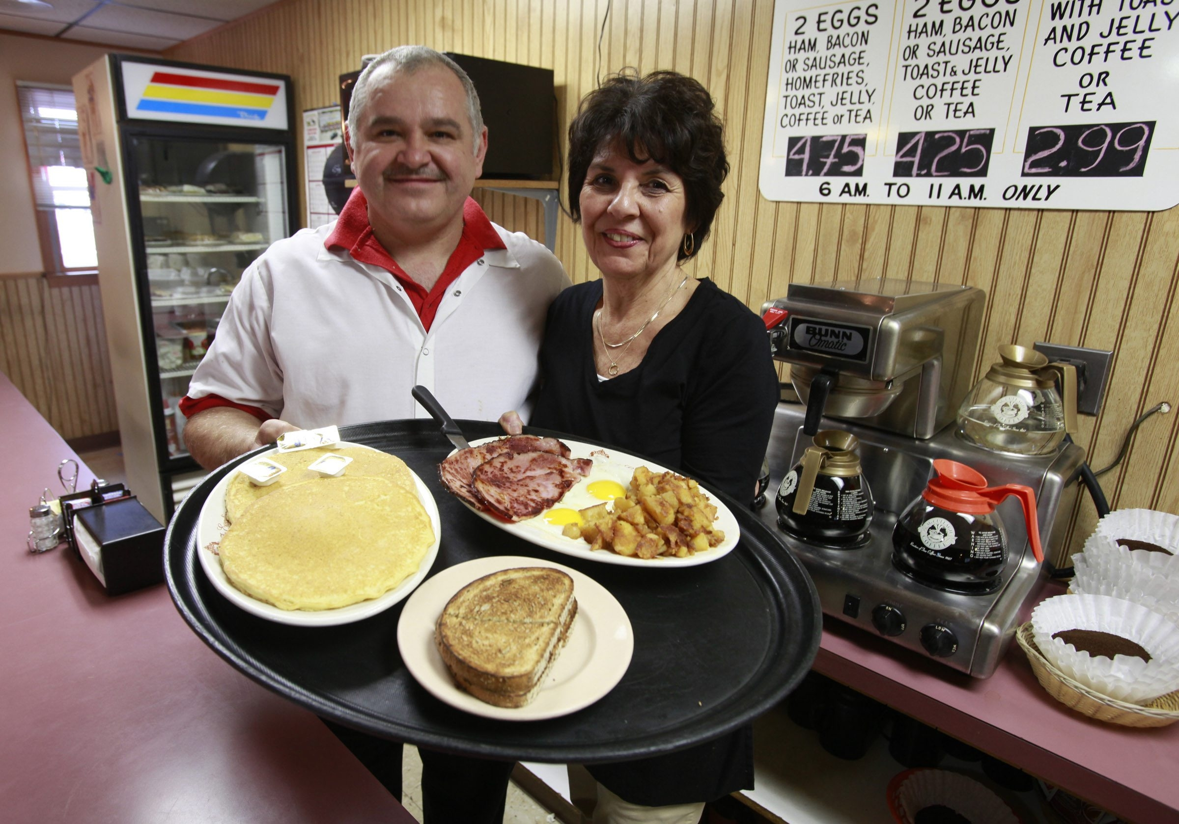 Owner Josif Popjanevski and longtime waitress Virginia Freer display the Hungry Man Breakfast at Three Star Family Restaurant in North Collins.