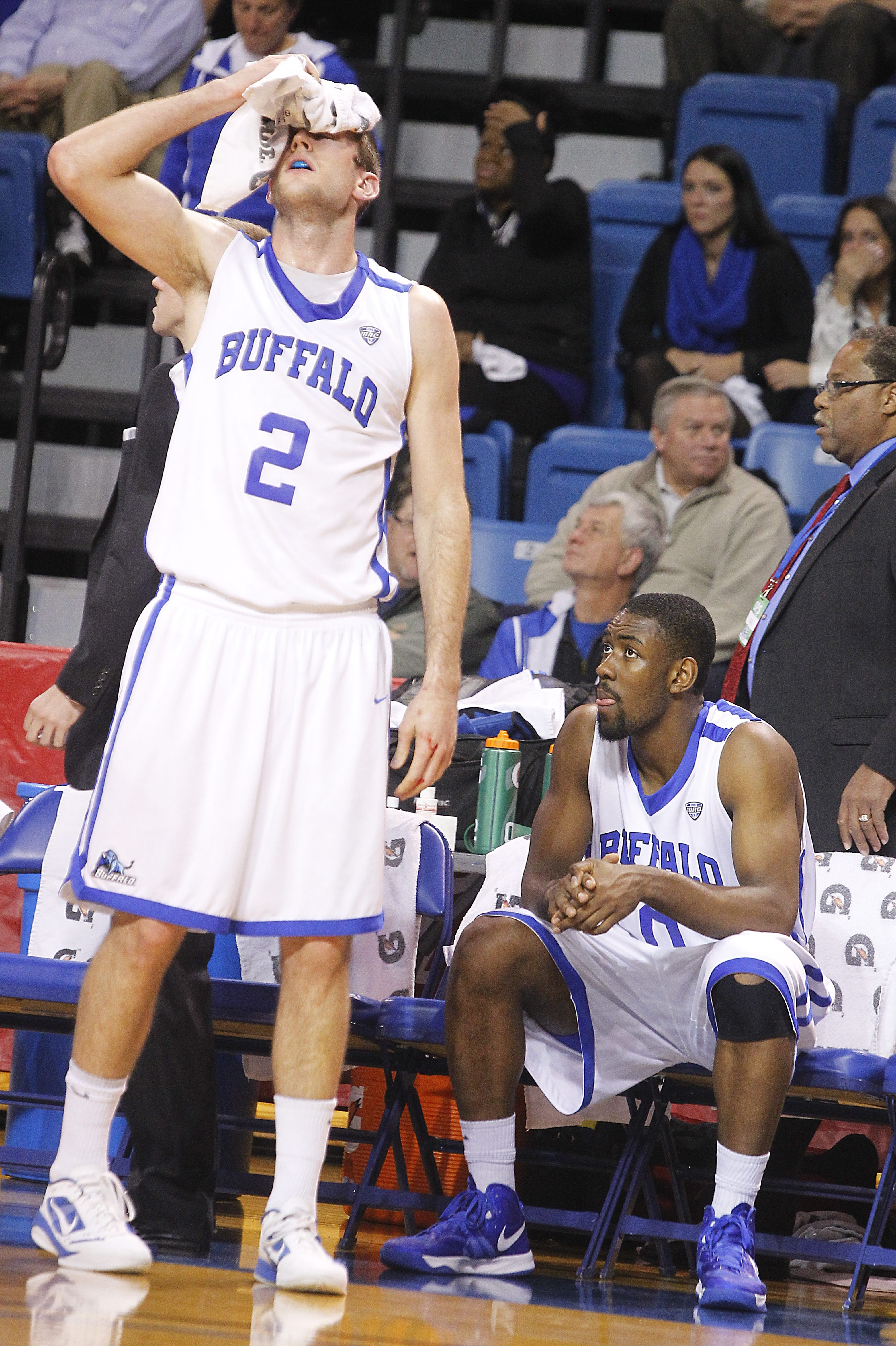 UB's Will Regan applies ice to his forehead after a Temple player elbowed him in the first half.