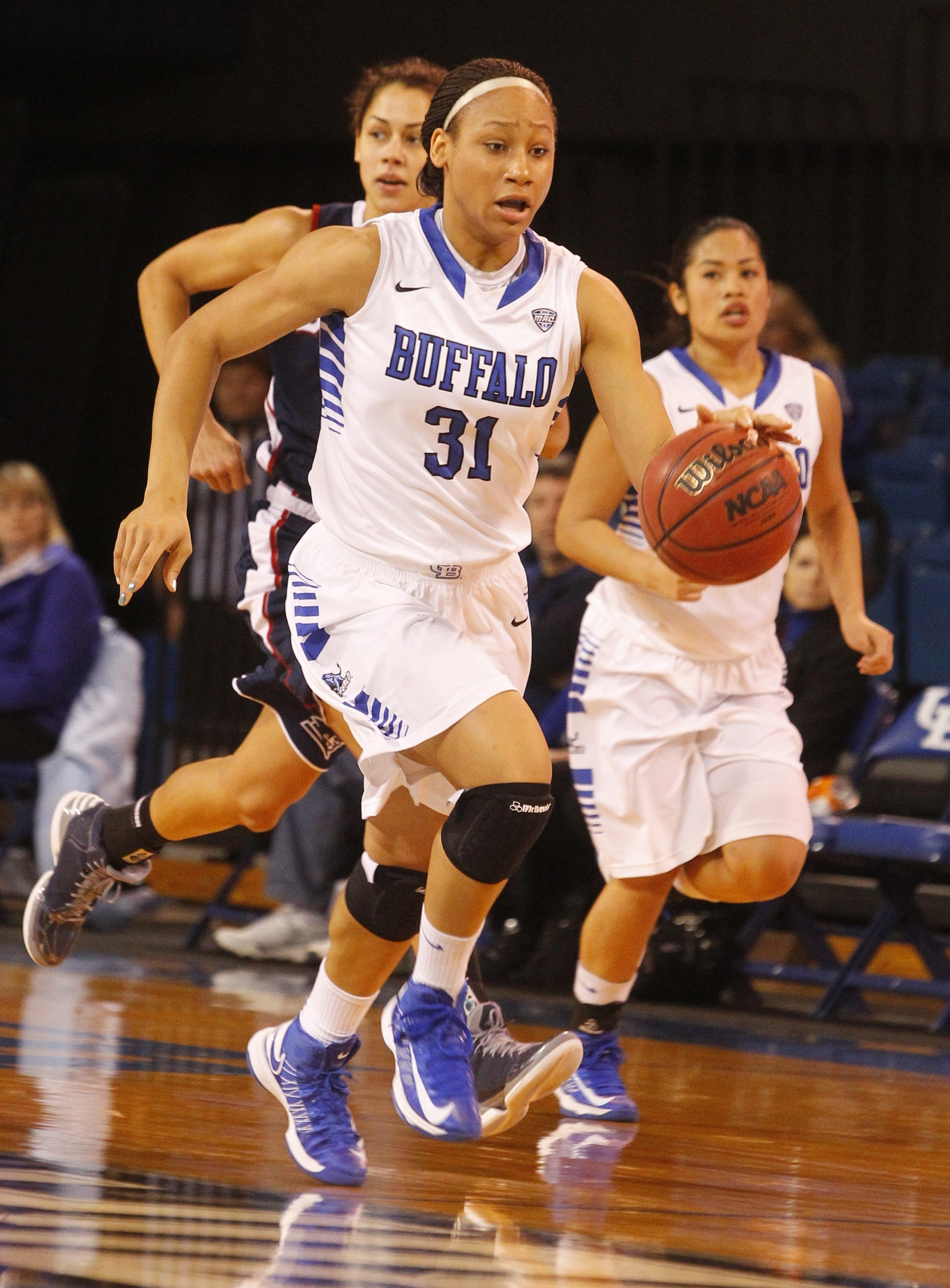 Buffalo's Rachael Gregory (31) goes out on the fast break against Duquesne.