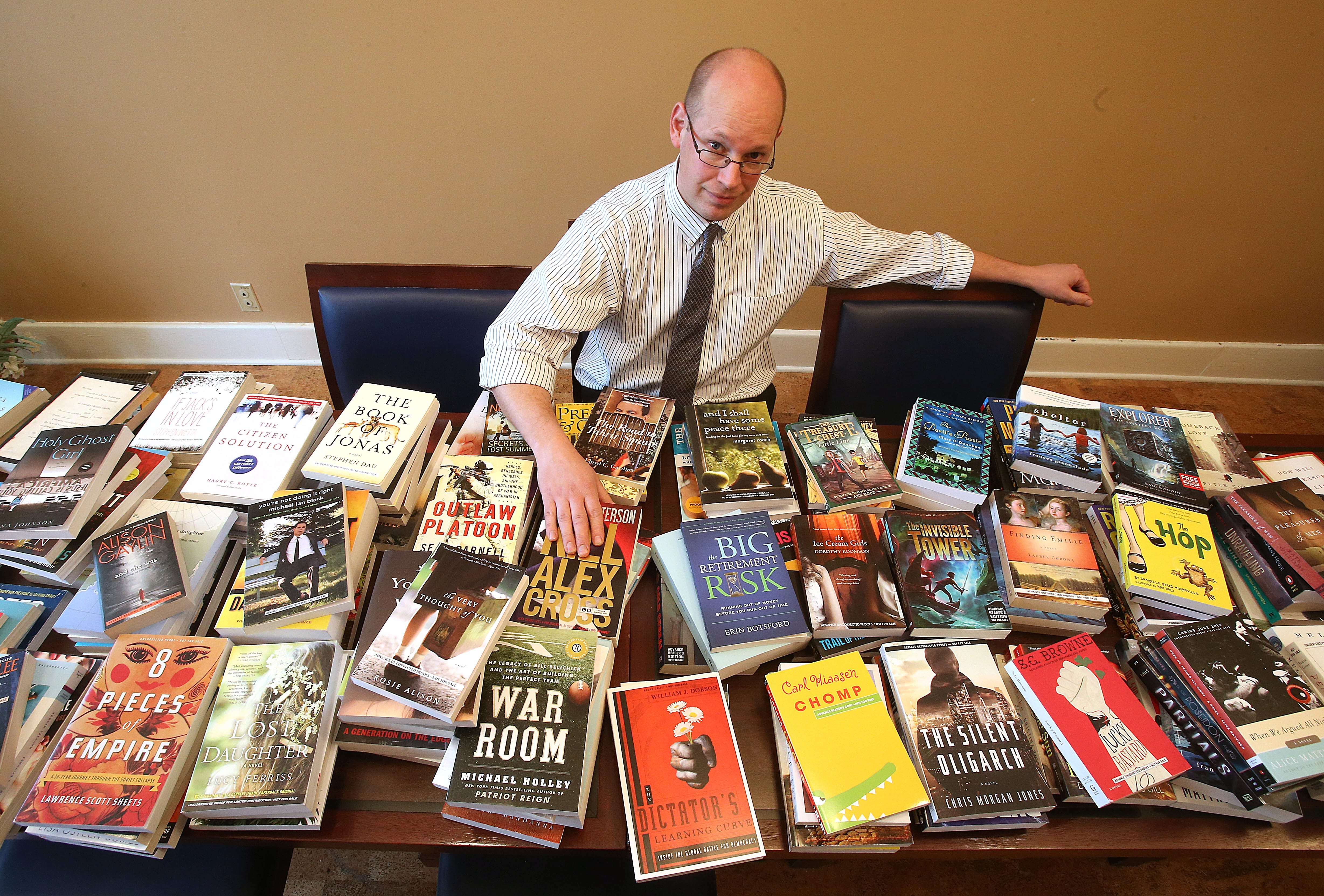 Ben Johnson, Parkside Community Association executive director, shows some of the books that will be available.