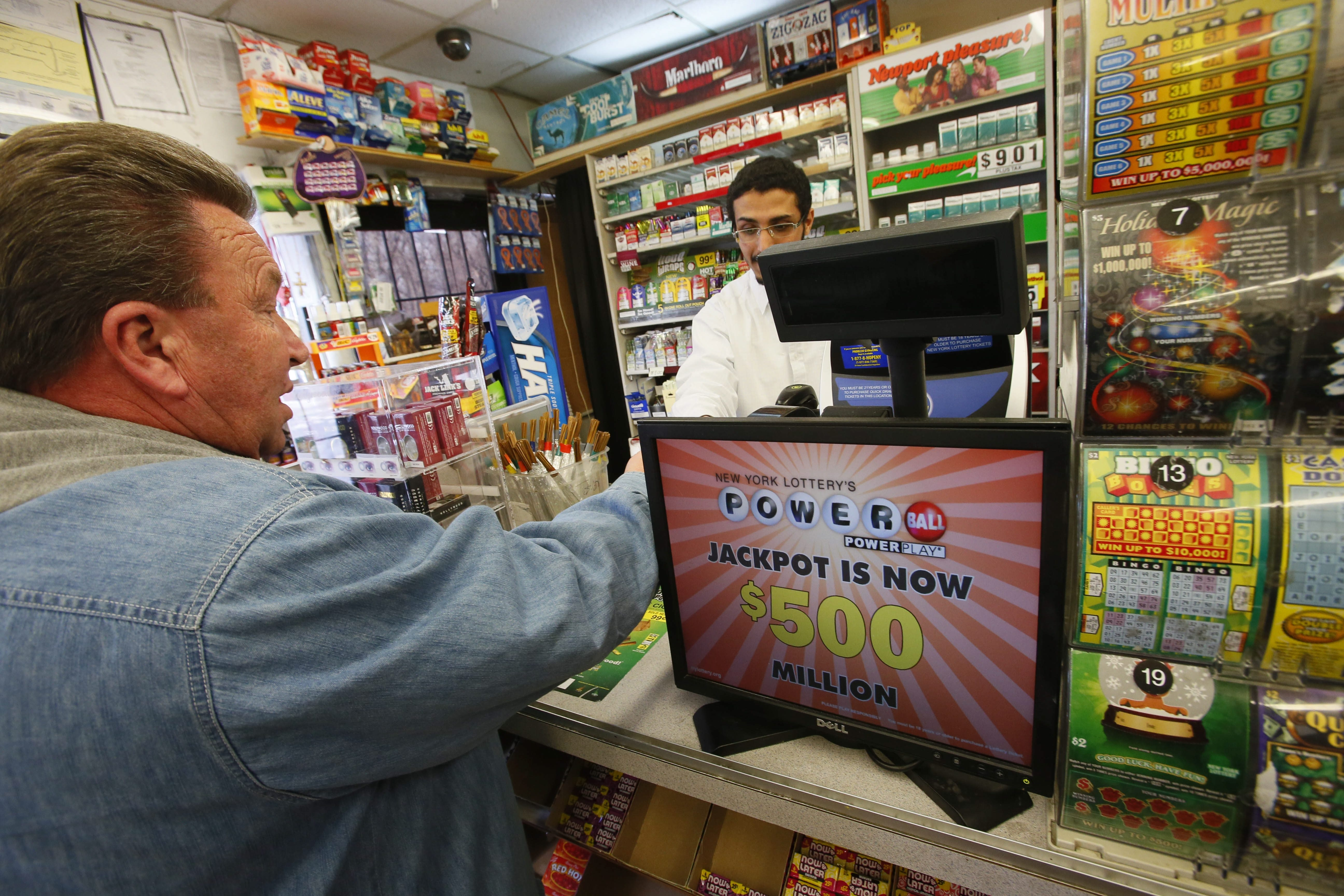 Wayne Anderson of Lackawanna buys Powerball tickets from Abraham Altalas at the Getty station in Lackawanna, Tuesday. The jackpot is one of the biggest in history.