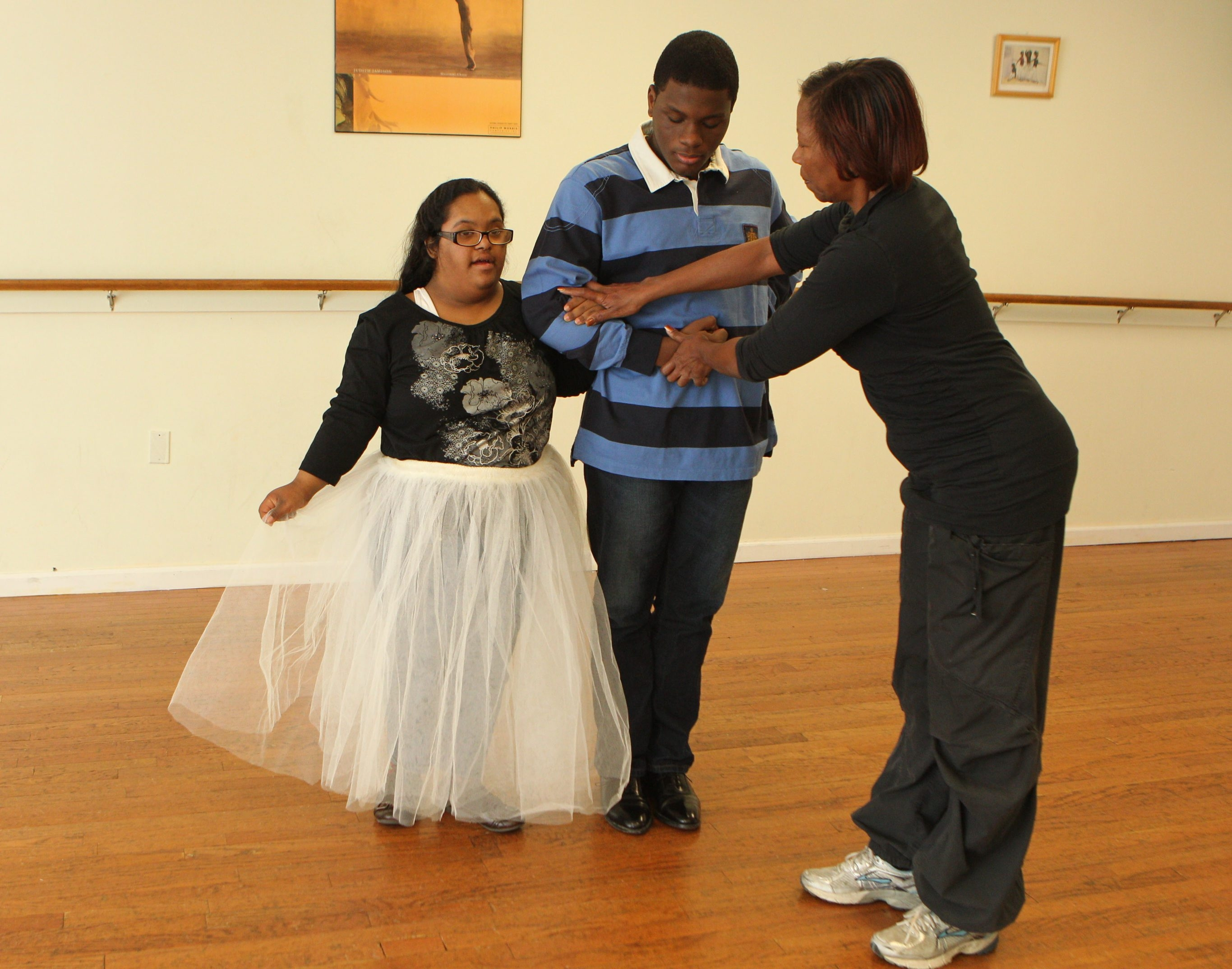 Barbara Glover, right, owner of Miss Barbara's School of Dance, teaches the waltz to Marriza Ayanna Evans, 18, left, and Nigel V. Jacobs, 14, who will attend the Debutante Ball on Saturday.