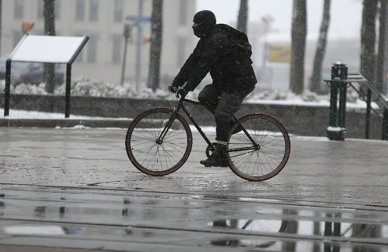 A bicyclist rides through Lafayette Square on Main Street in downtown Buffalo.