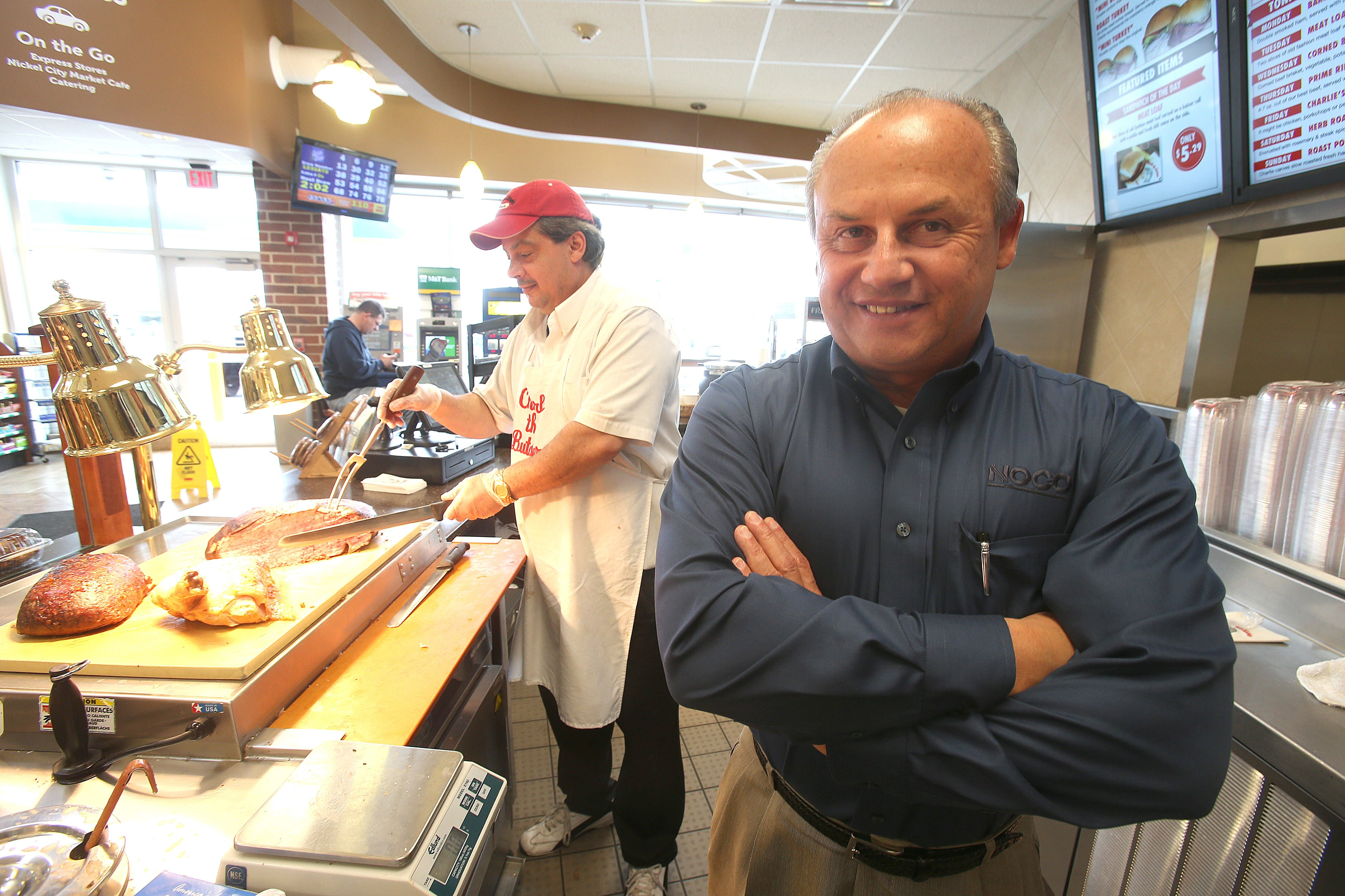 Noco executive Paul Wydro, right, with Charlie the Butcher carver Edgardo Fontanez at the store at Genesee Street and Holtz Drive in Cheektowaga.