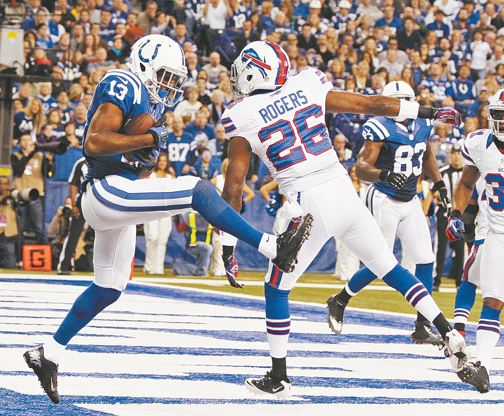 Colts wide receiver T.Y. Hilton pulls in an 8-yard touchdown pass from Andrew Luck behind Bills cornerback Justin Rogers during the third quarter.