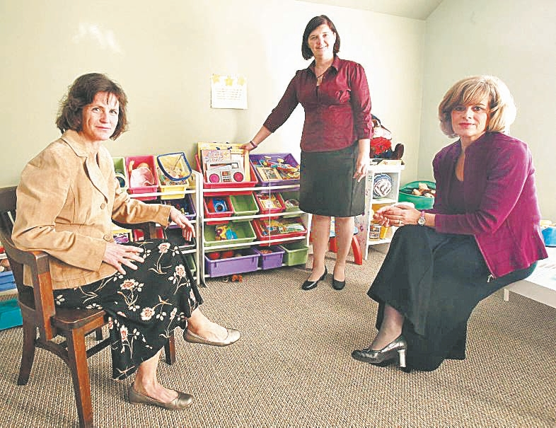 Mary Travers Murphy, right, Lisa Henrich, left, and Tiffany Szymanek show off the playroom at the Southtowns Family Justice Center in Orchard Park, which opened in February.
