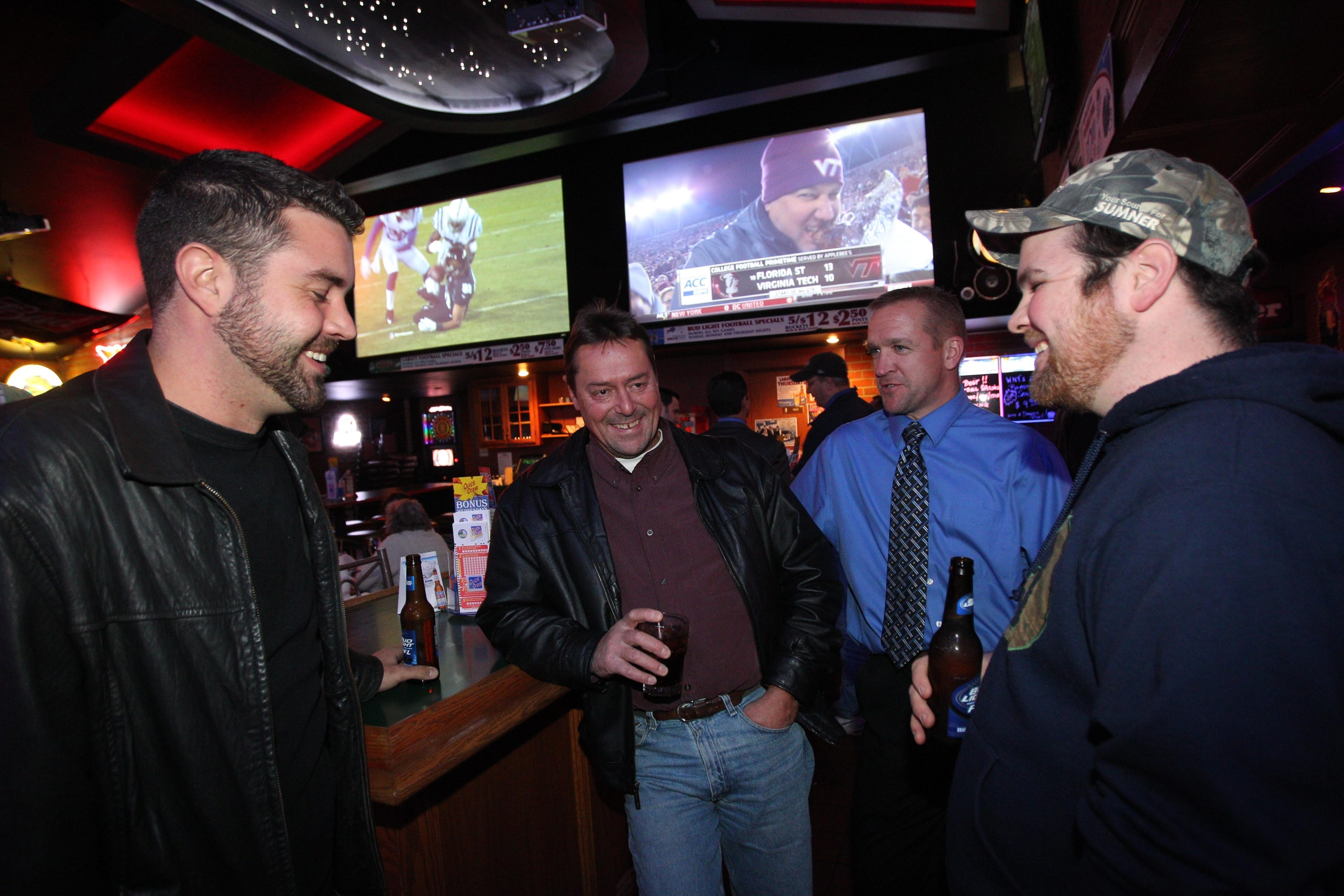 Hanging out and catching some football in the bar area at Tony Rome's are, from left, Mike Nuttle, Tim Franger, Jeff Zubler and John Shafer.