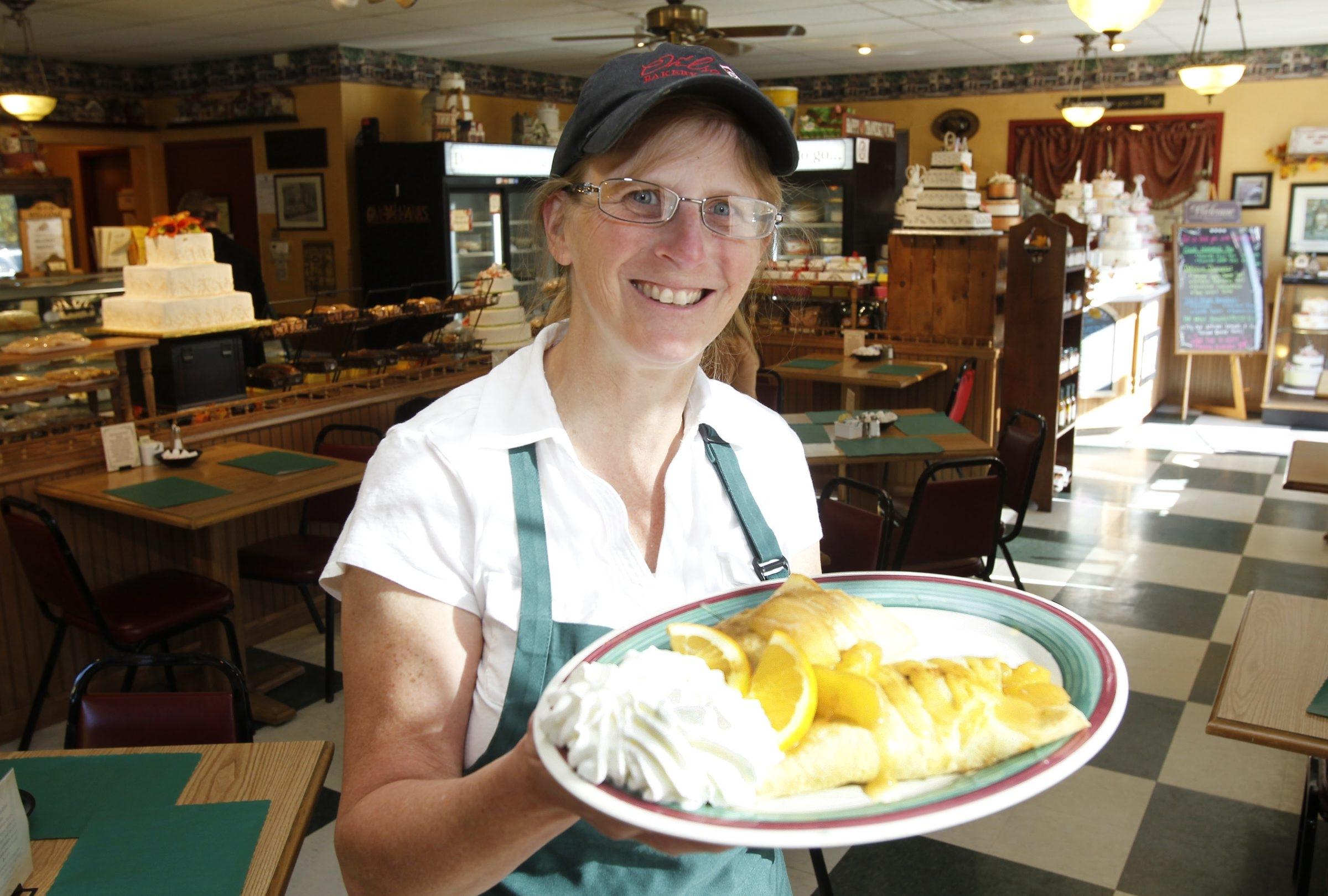 Owner Lisa Ohlson shows off an apple cinnamon crepe.