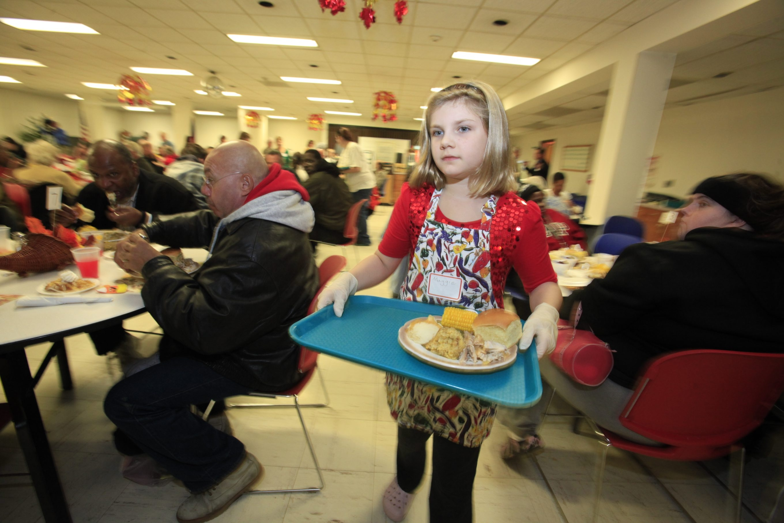 Thanksgiving is a day to help the less fortunate. Maggie Ingalls, 9, served up Thanksgiving dinner  at the Salvation Army in Buffalo last year.