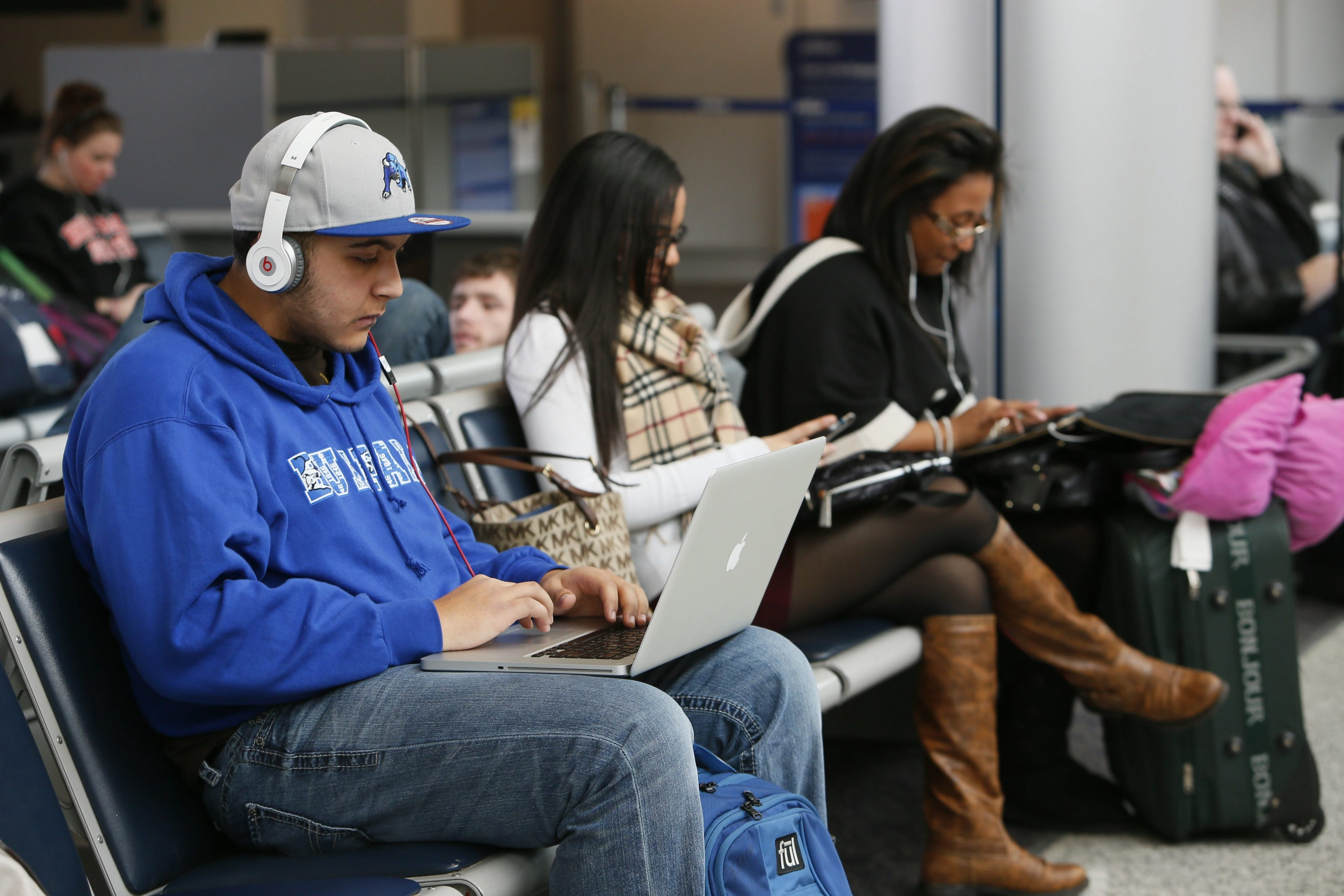 UB student Kush Grover gets comfortable at the Buffalo Niagara International Airport Tuesday while waiting for his flight home.
