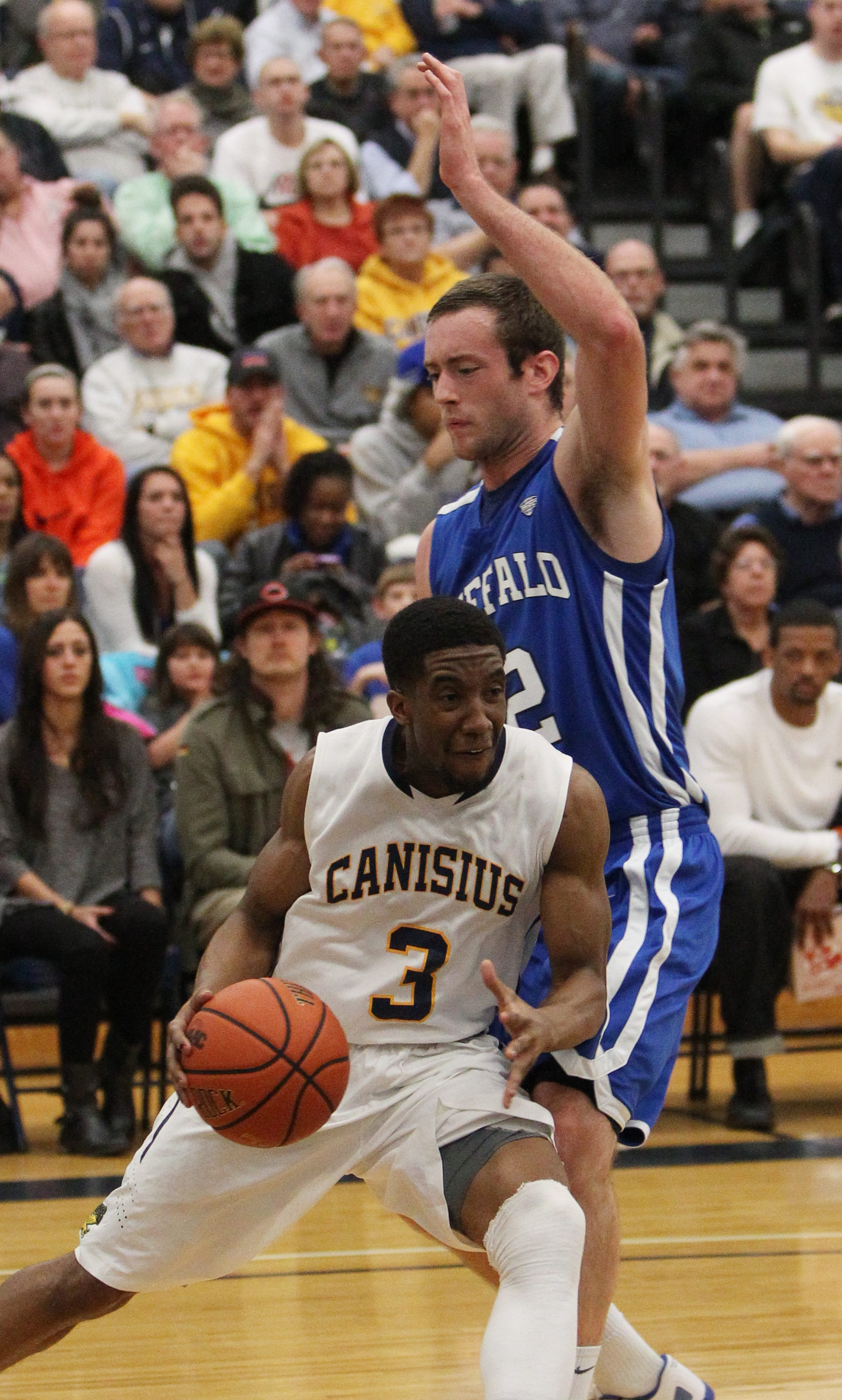 Canisius' Harold Washington tries to drive around UB's Will Regan during Tuesday night's game.